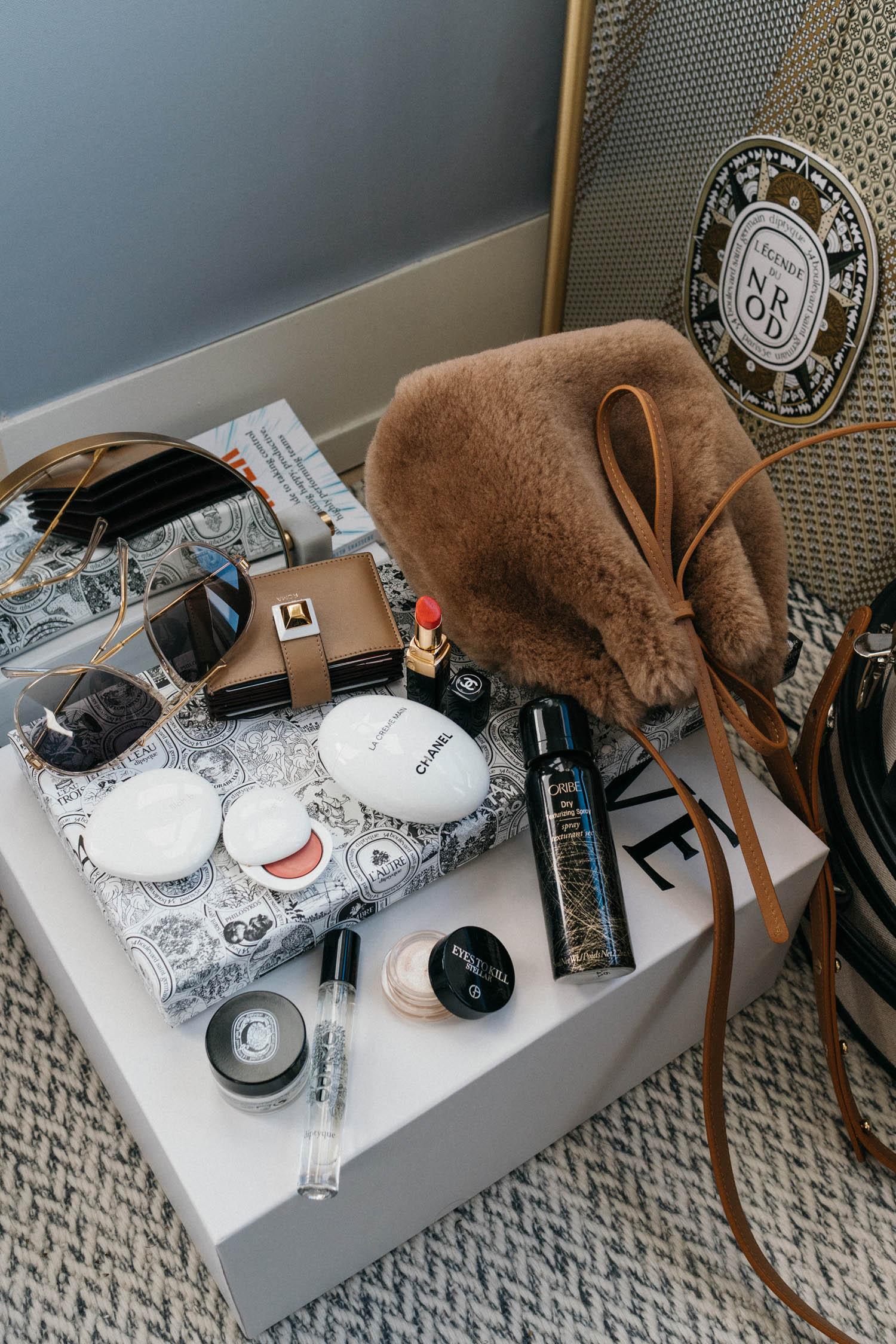 Céline Sunglasses ,  Lilah B Blush ,  CHANEL Hand Cream ,  CHANEL Lipstick , Fendi Wallet, Diptyque Fragrance, Diptyque Cream,  Oribe Spray ,  Mansur Gavriel Bag