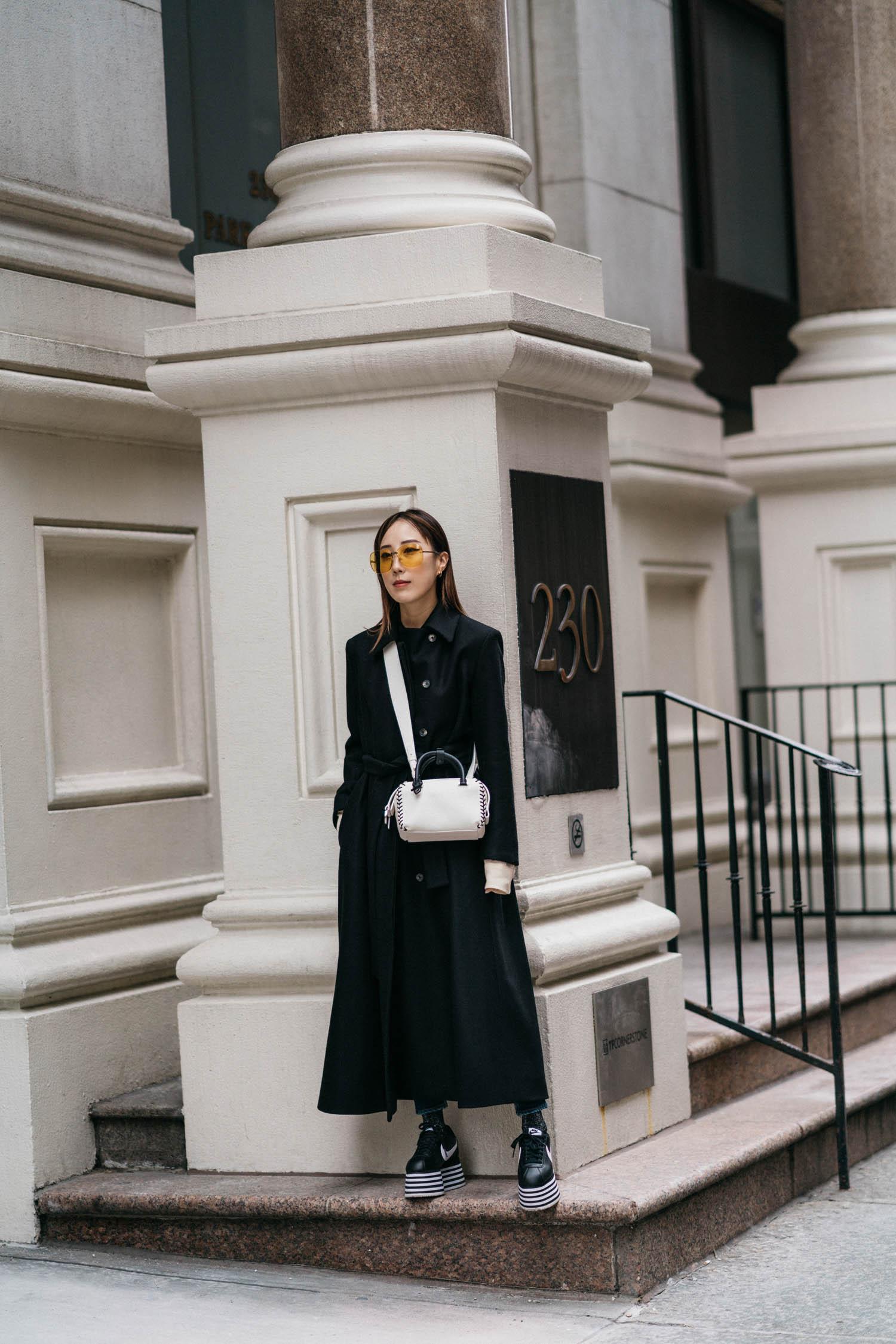 The Row Coat ,  Delvaux Bag ,  Comme des Garçons Sneakers , Gucci Sunglasses