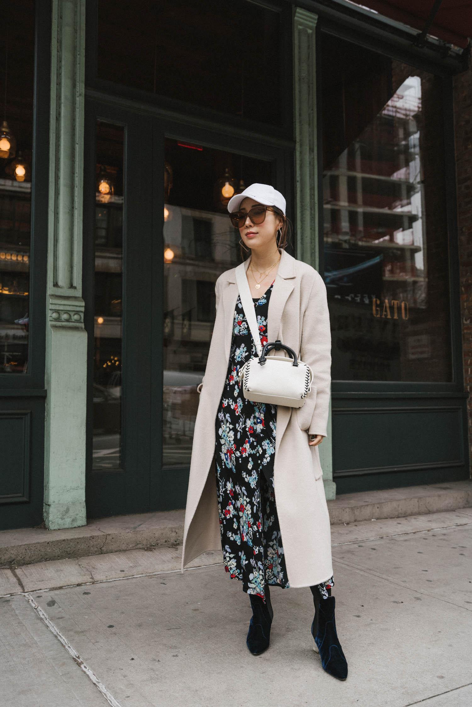 Sézane Coat, Rixo Dress,  Delvaux Bag , Alaïa Boots,  Balenciaga Hat , Gentle Monster Sunglasses,  Area Earrings