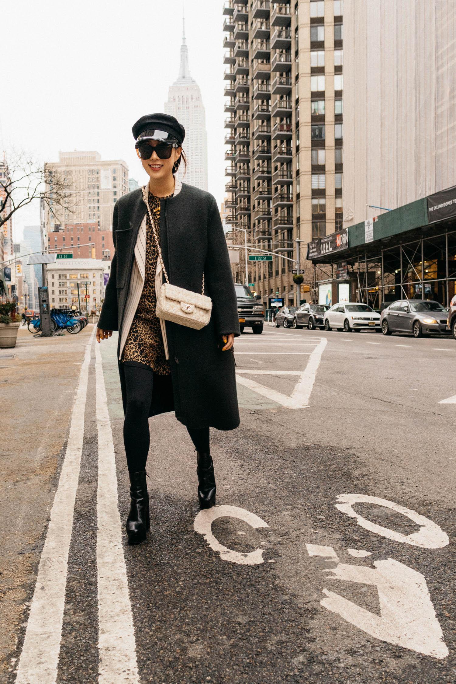 Kuho Coat, Les Coyotes de Paris Blazer, Saint Laurent Dress, Alexander Wang Boots, CHANEL Bag, Gucci Hat, Celine Sunglasses