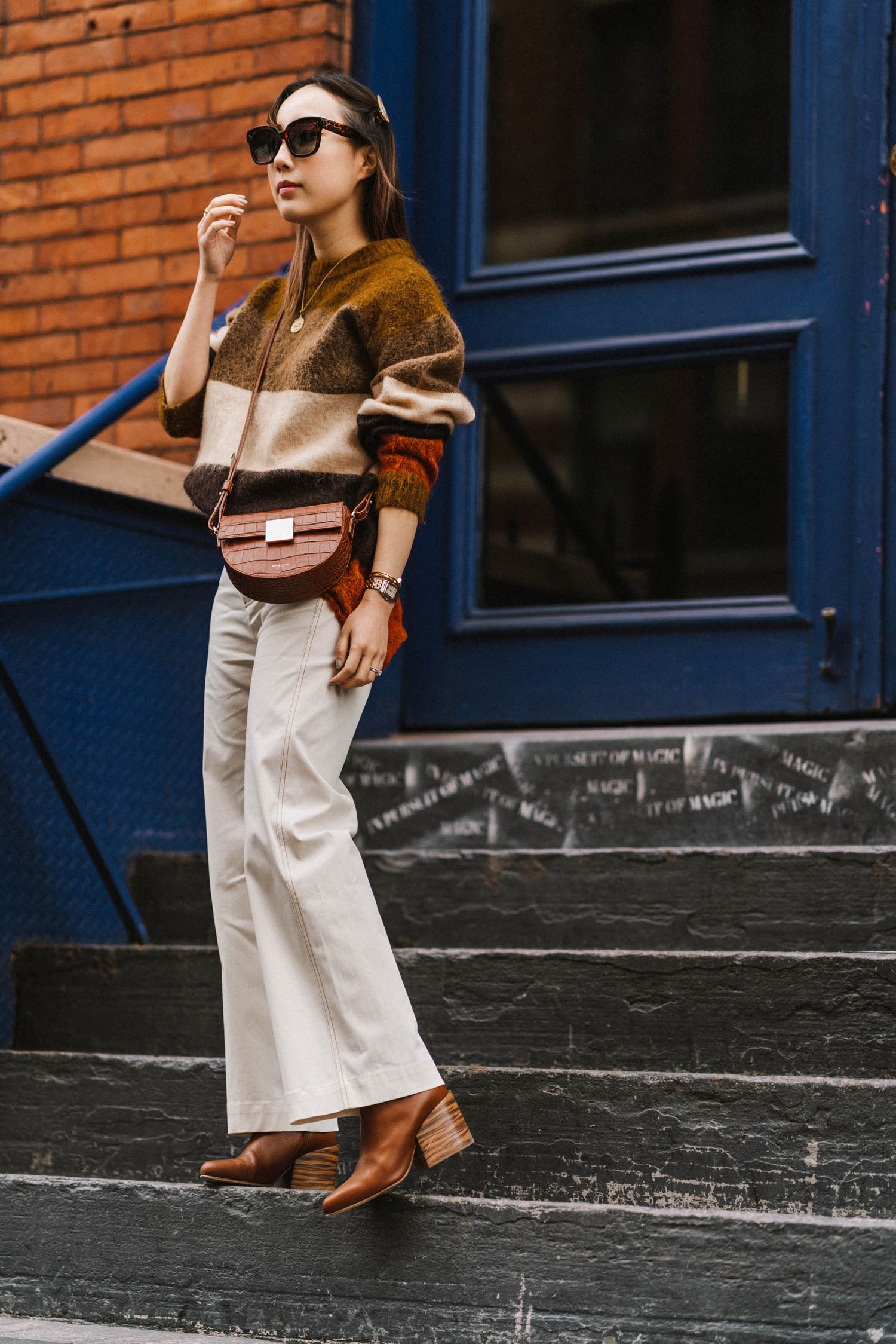 Acne Studios Sweater,  SEA New York Pants , Gabriela Hearst Boots,  Demelier Bag , Céline Sunglasses, Cartier Watch