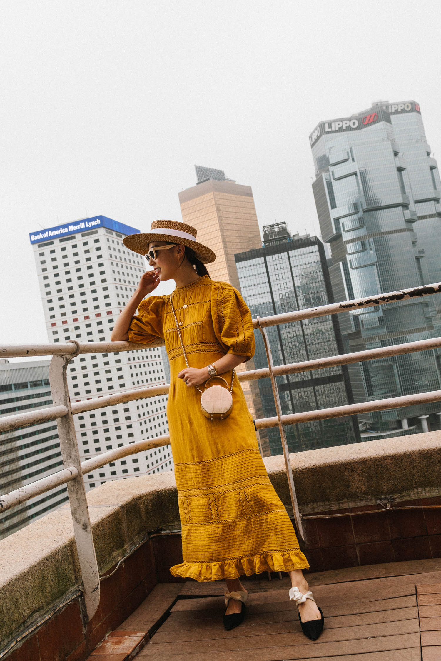Sea New York Dress ,  The Row Shoes ,  Aspinal of London Bag , Eric Javits Hat, Celine Sunglasses