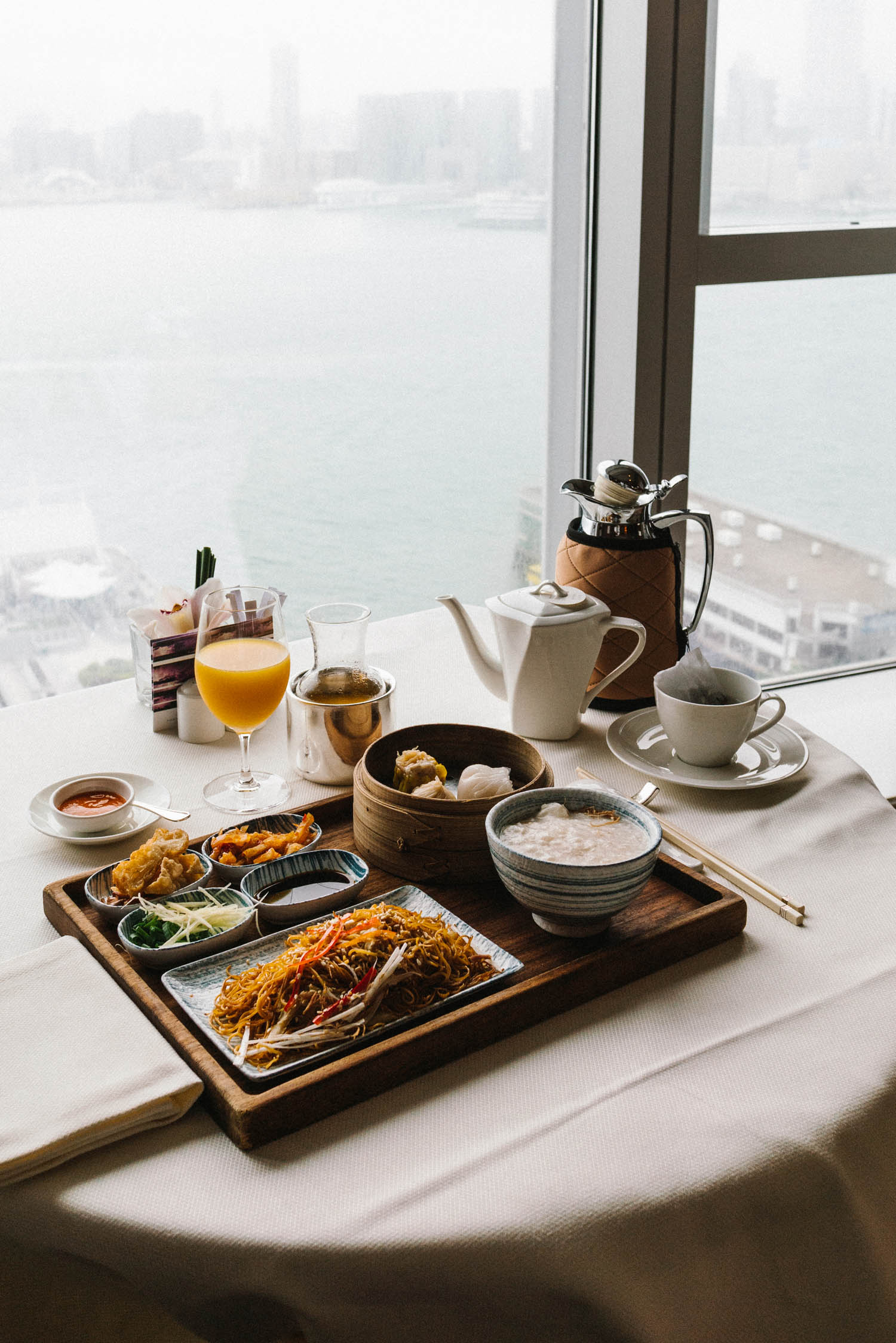 Chinese breakfast of congee, dimsum, and stir-fried noodles for in-room dining