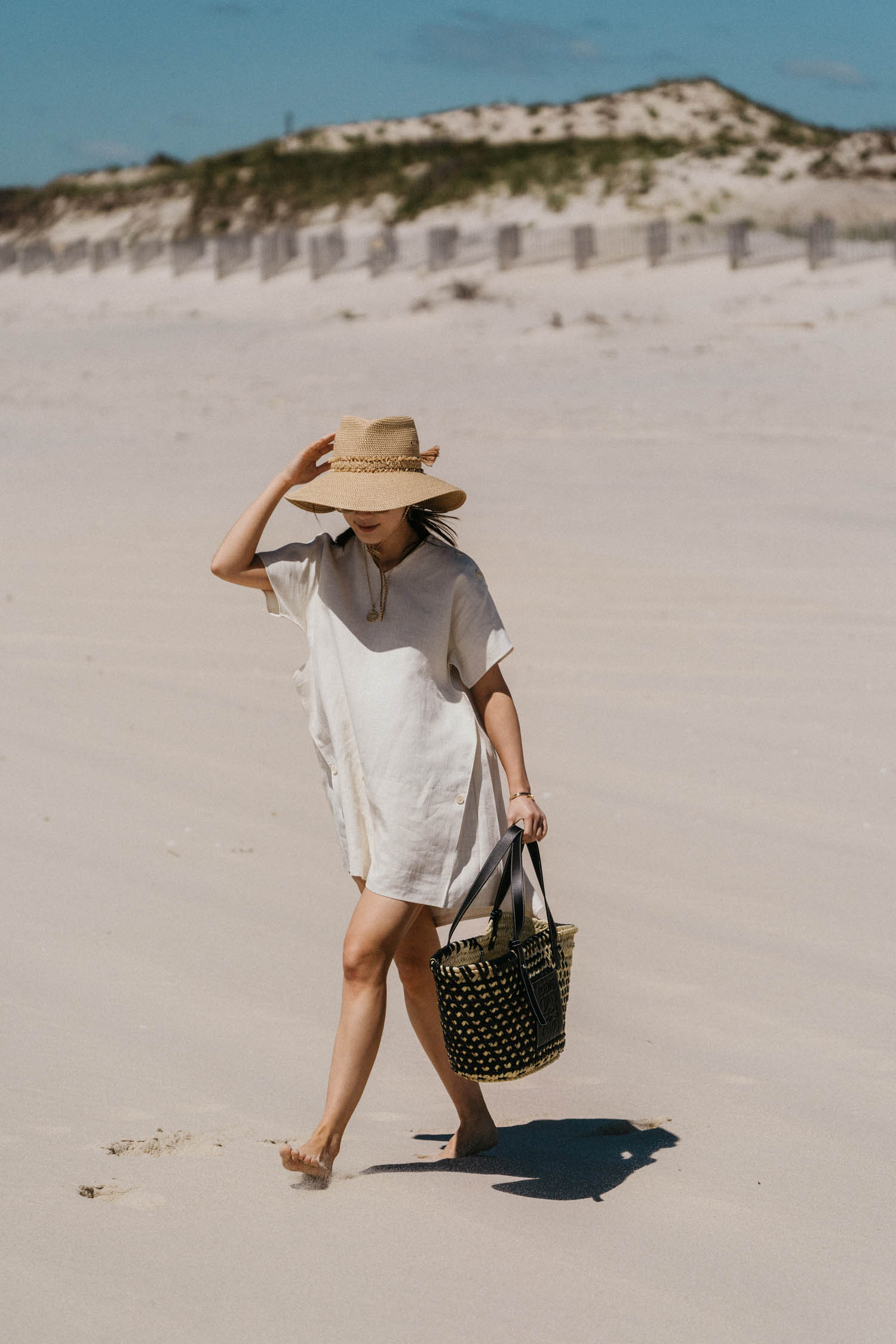 Jil Sander Dress,  Loewe Bag , Eric Javits Hat, Celine Sunglasses,  Azlee Necklace