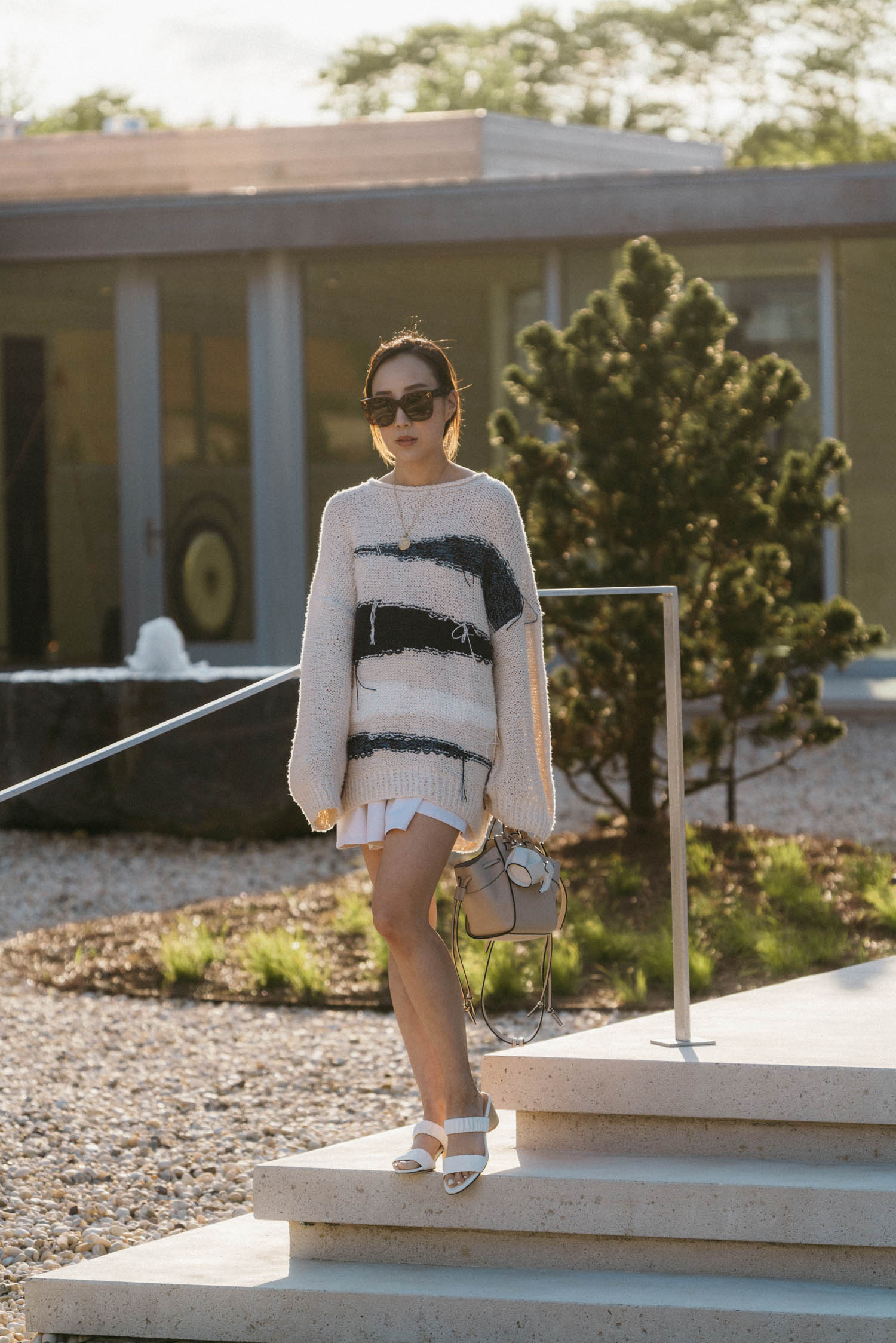 Tomorrowland Sweater, COS Shorts,  Dear Frances Sandals ,  Loewe Bag , Celine Sunglasses