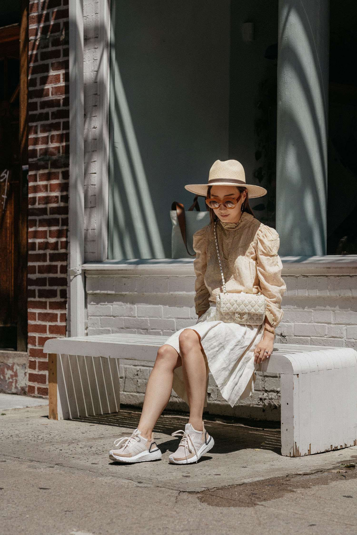 Doen Top , JW Anderson Skirt, CHANEL Bag,  adidas Shoes ,  Lapima Sunglasses , Janessa Leone Hat,  WWAKE Earrings