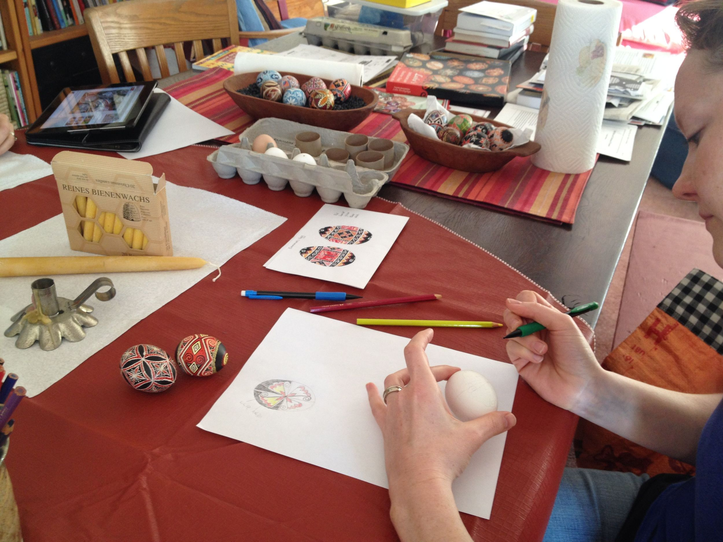 Sketching designs onto the eggs