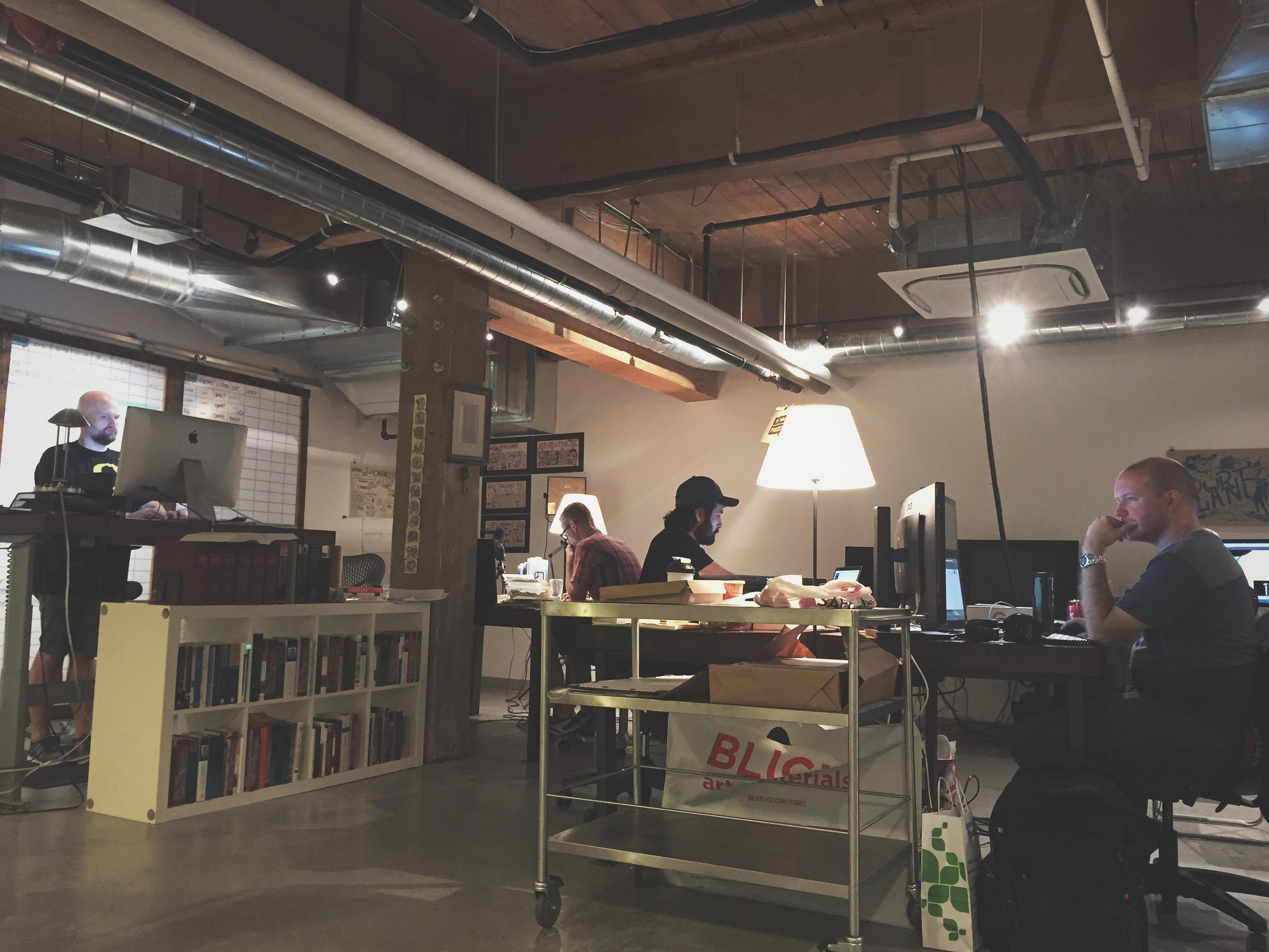 A partial view of The Bible Project's headquarters. Turning around, one would see the desks of the animators along with more shelves of books.