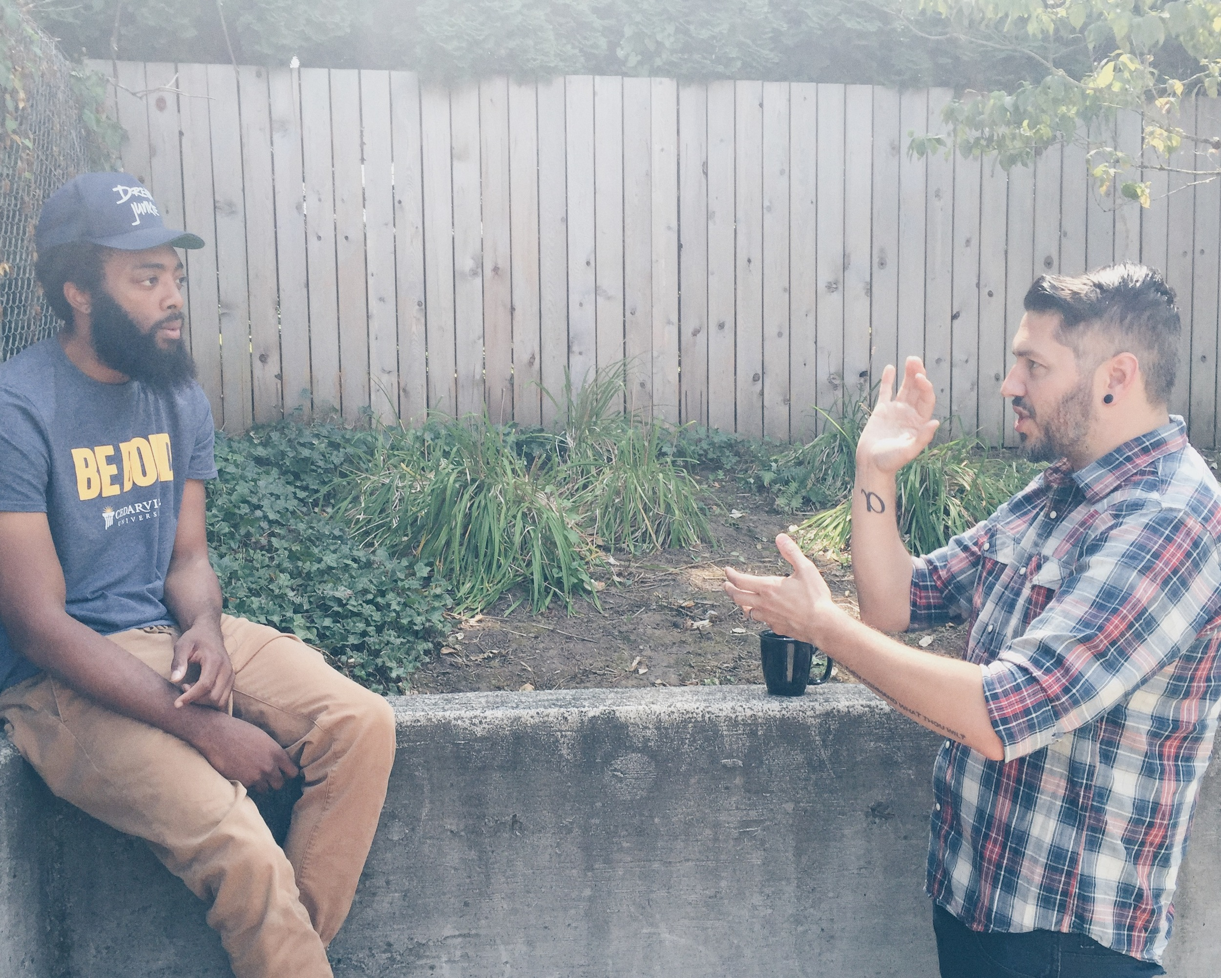 Thomas (on the right), talks to his labelmate, JGivens (on the left), discussing plans for an upcoming music video.