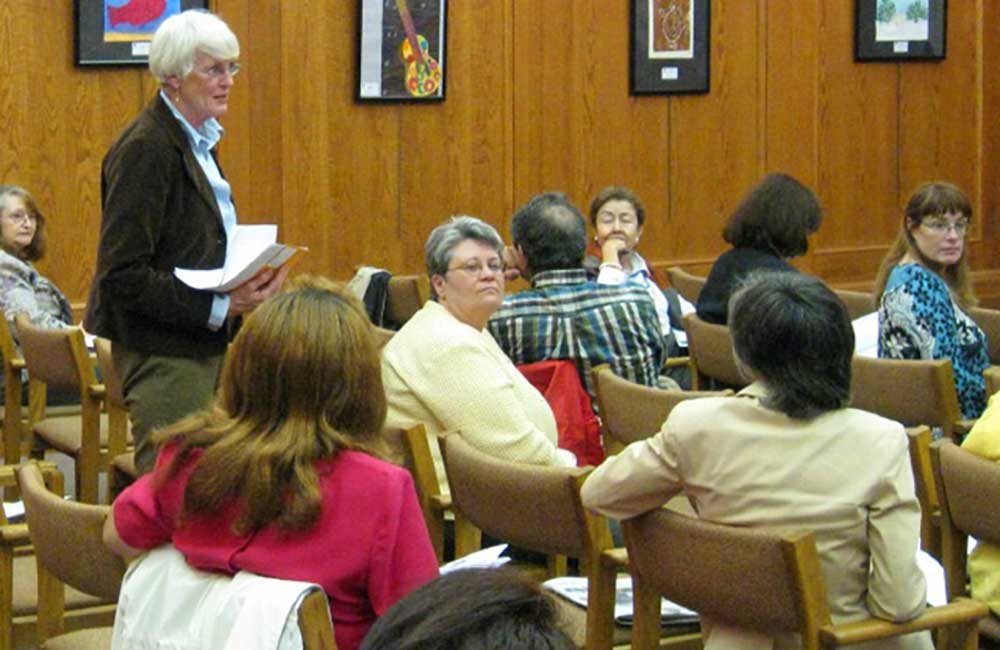 (2003)   Nan Parson of Park Ridge updates other north suburban fair and affordable housing advocates at Open Communities' Fair Housing Month event in 2009