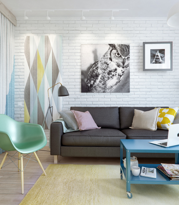 A modern geo print in calm pastels painted on the wall is repeated with pops of pastel in the chair, rug and pillows. Image Source: Living in a Shoebox Blog