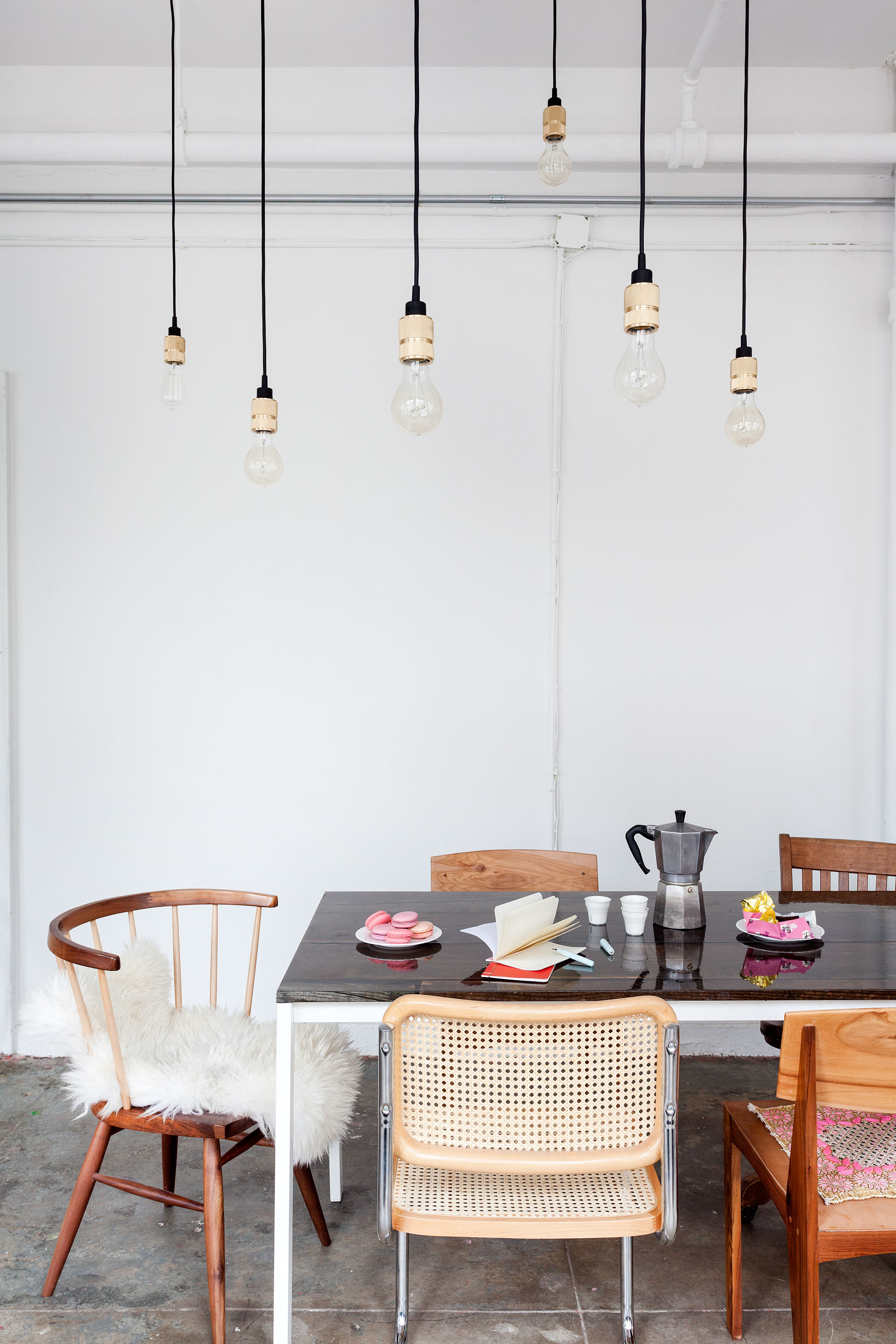 """Image Source:  The Witness  via MyDomaine, """"The Do's and Don'ts of Decorating with Mismatched Chairs""""."""