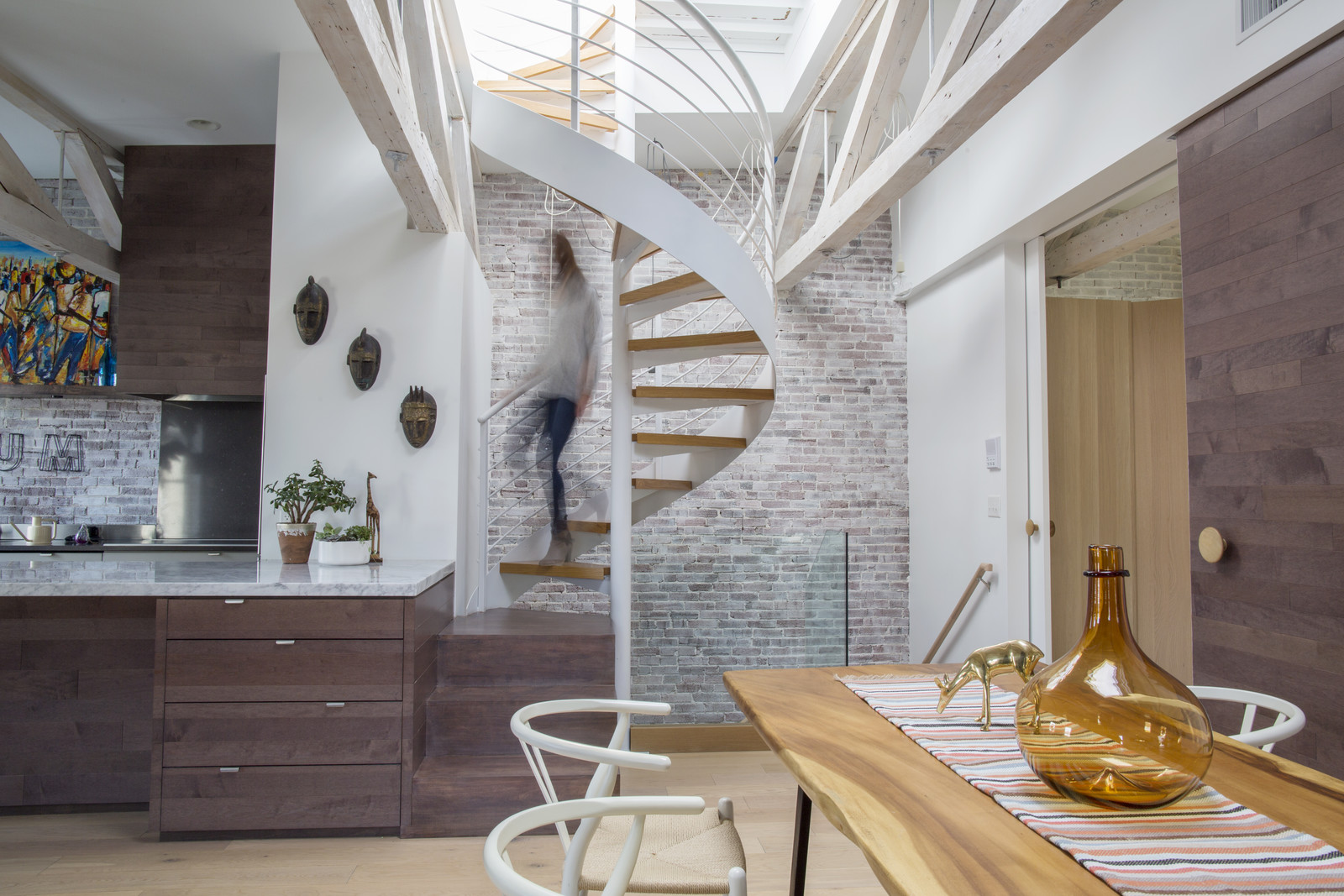 This beautiful space renovated by the owner, Alan Ricks, meshes clean, modern lines with craft details and punctuates it all with incredible art from around the world that the family collected during their travels.  If you love spaces with a global eclectic look, this is definitely a tour you'll want to walk through.   Source:  Dwell Magazine Online