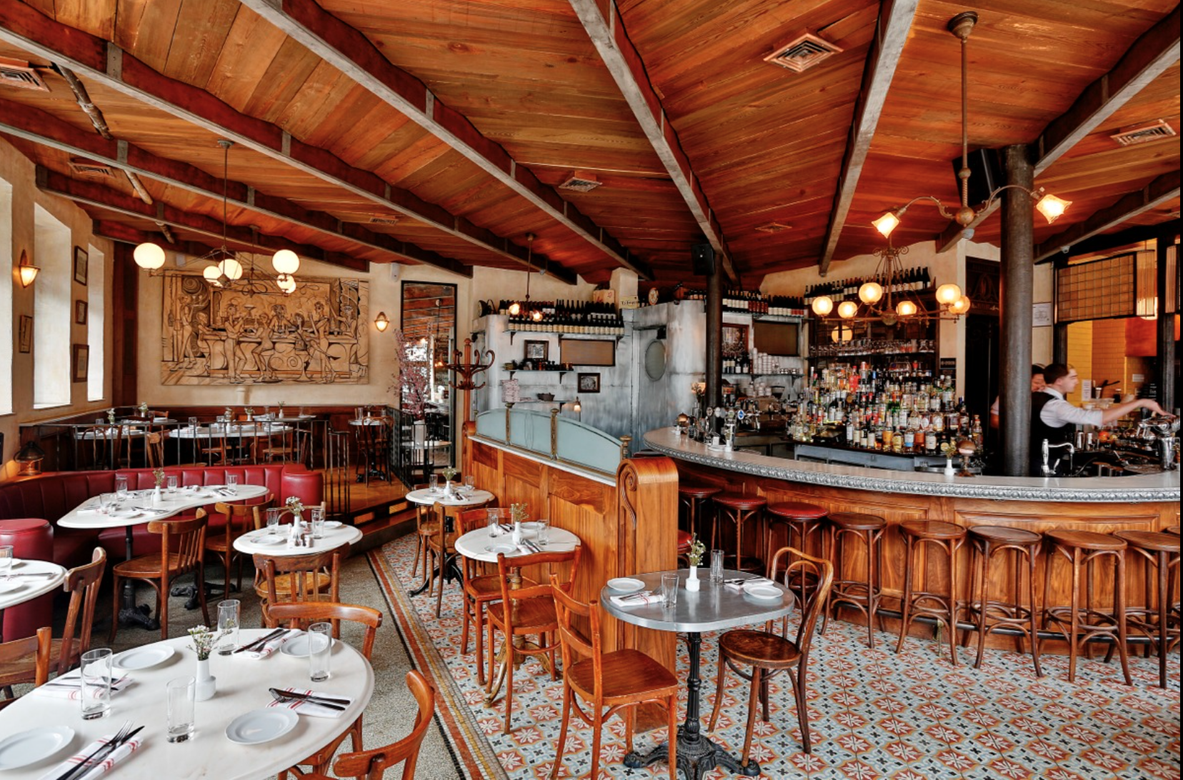 This is an inspiration shot of a restaurant in Williamsburg, Brooklyn that mixes floor tiles and features raised wood floor areas and upholstered (short) banquettes.  The tone of the wood is different but it gives a sense of how a more colorful tile plays in the space. Source: http://www.witlofnyc.com/galleries/restaurant