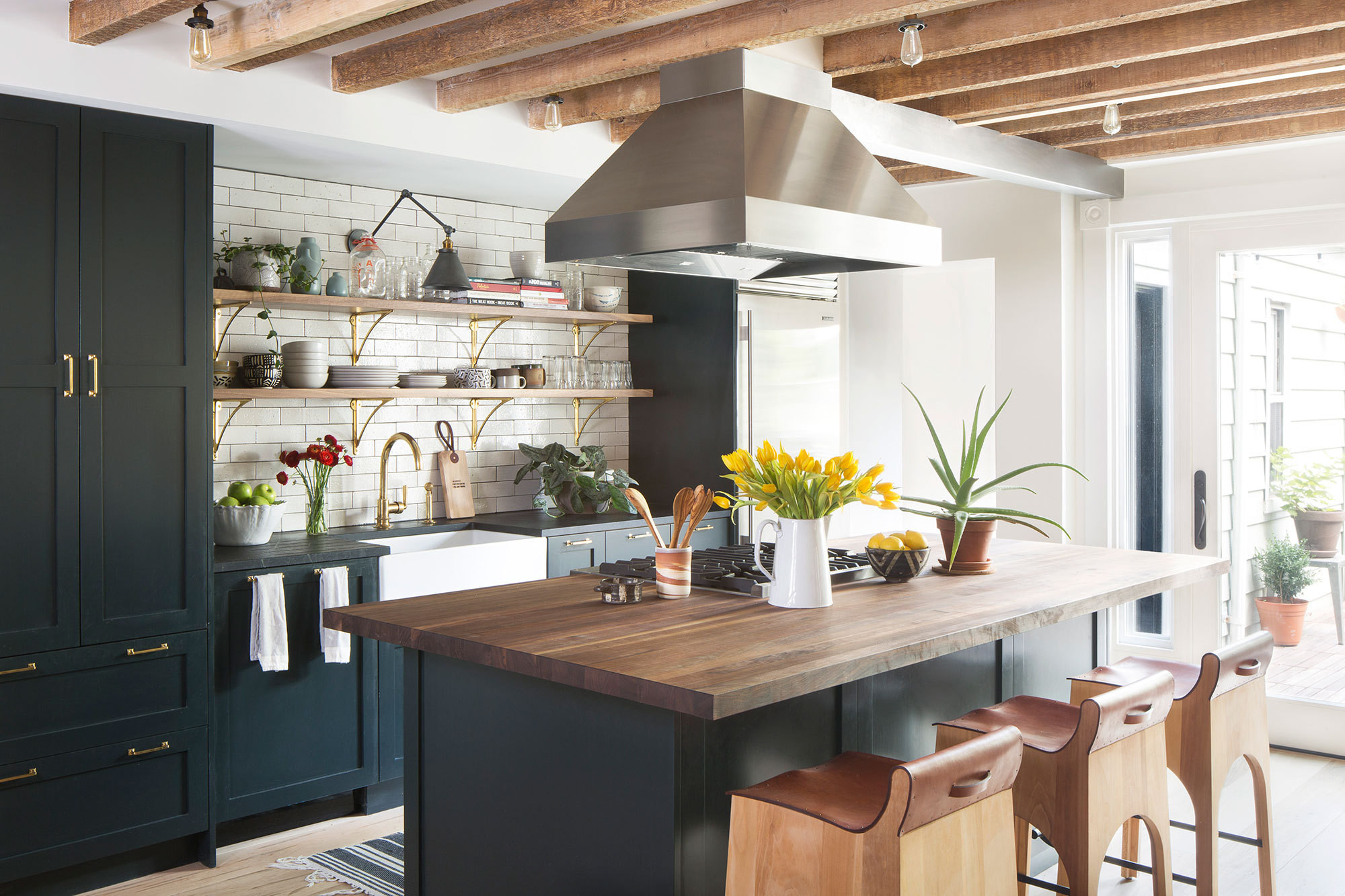 The attention to detail in this stunning open kitchen is pretty impressive. That same focus is given throughout this beautifully renovated Brooklyn townhouse, so if you love the brass hardware, ceiling beams and handsome leather straps on these unique counter stools - you'll want to check out the rest of this home.   Source:   Lonny