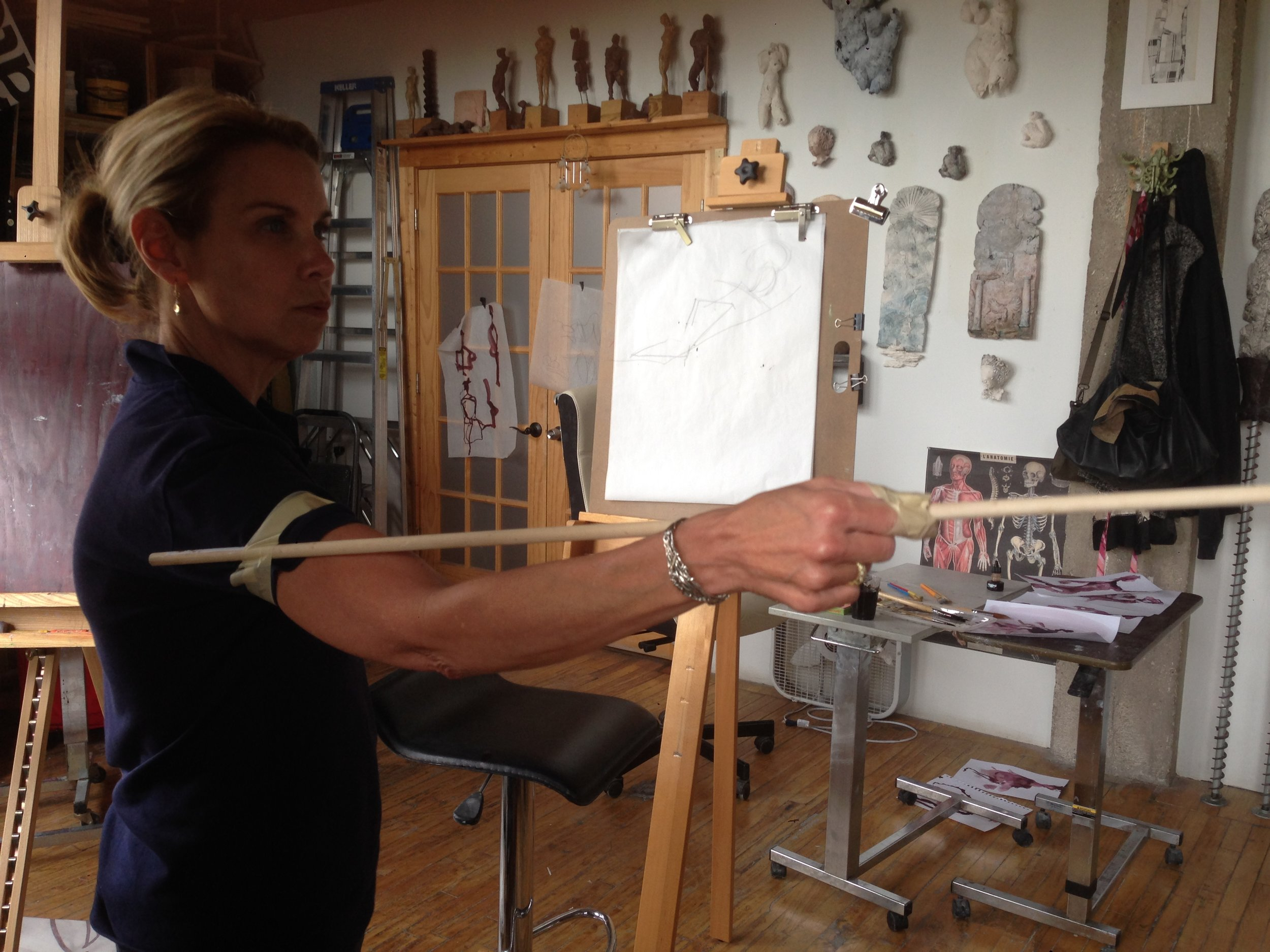 Mary using a lengthy brush to improve her skills! You go girl!