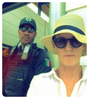 Confirmation bias in action - Whether you think Mexico is safe or not-safe will probably determine how you interpret this picture. My expat friends were amused (or just loved a man in uniform), my state-side friends alarmed, by this picture of me with a security guard outside a local bank. -