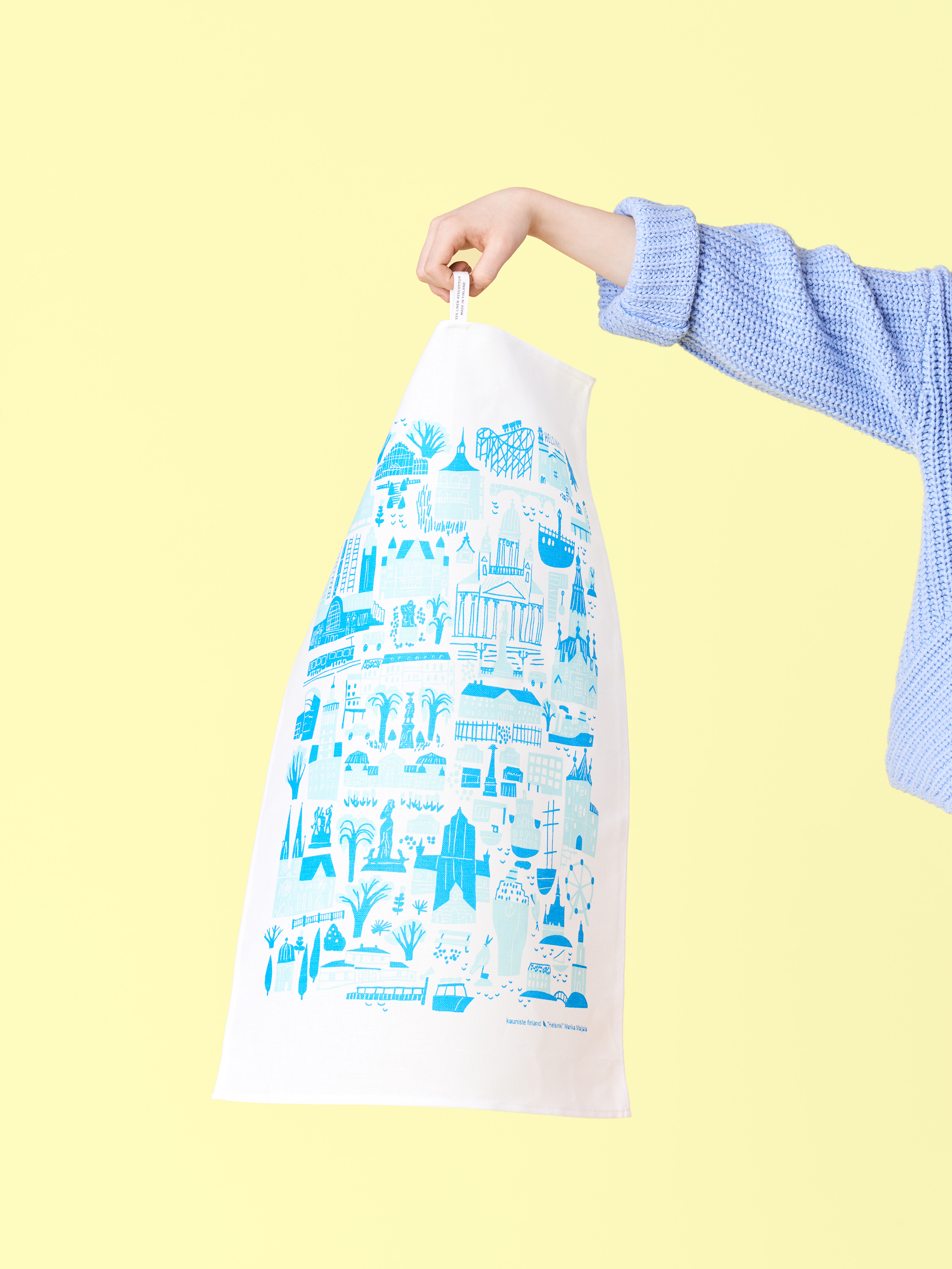 Helsinkikitchen towel - The kitchen towel features our favorite scenes from our beloved city. It is printed in Finland with water-based, non-toxic inks.