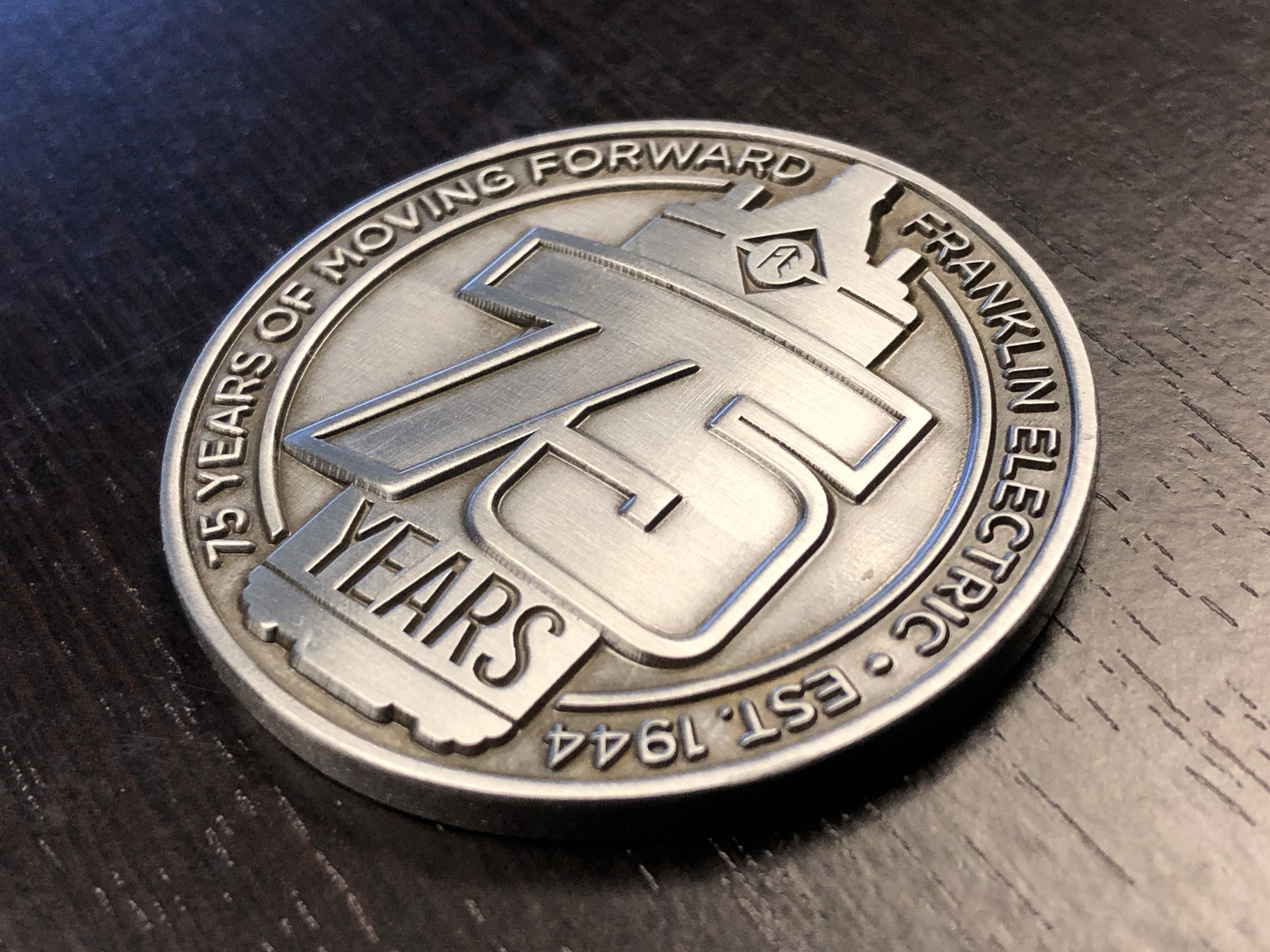 A limited-edition commemorative coin minted by Franklin Electric in celebration of 75 years.