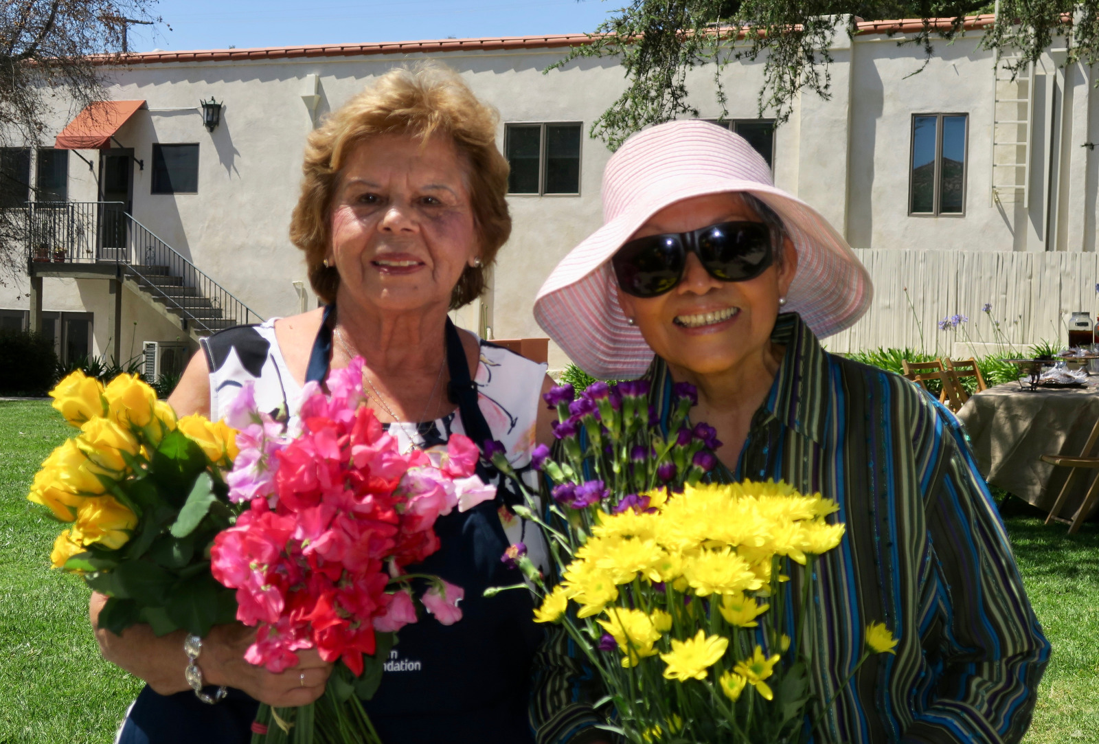 Volunteers Betty Dominguez and Carmen Romero, who have served for 19 years.