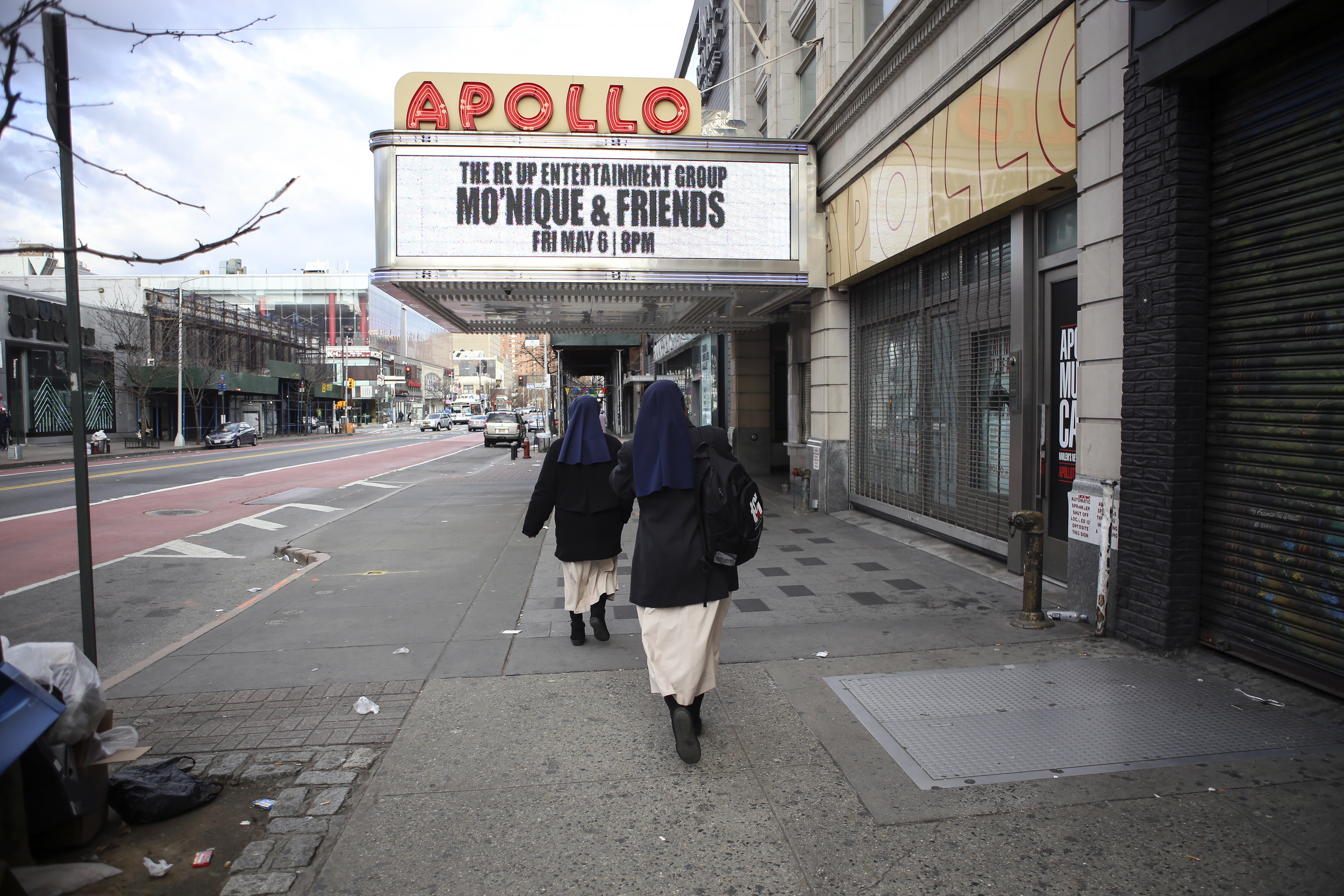 Sister Mary and Sister Anne Okori make their way from the mother house to the Church of St. Joseph of the Holy Family.