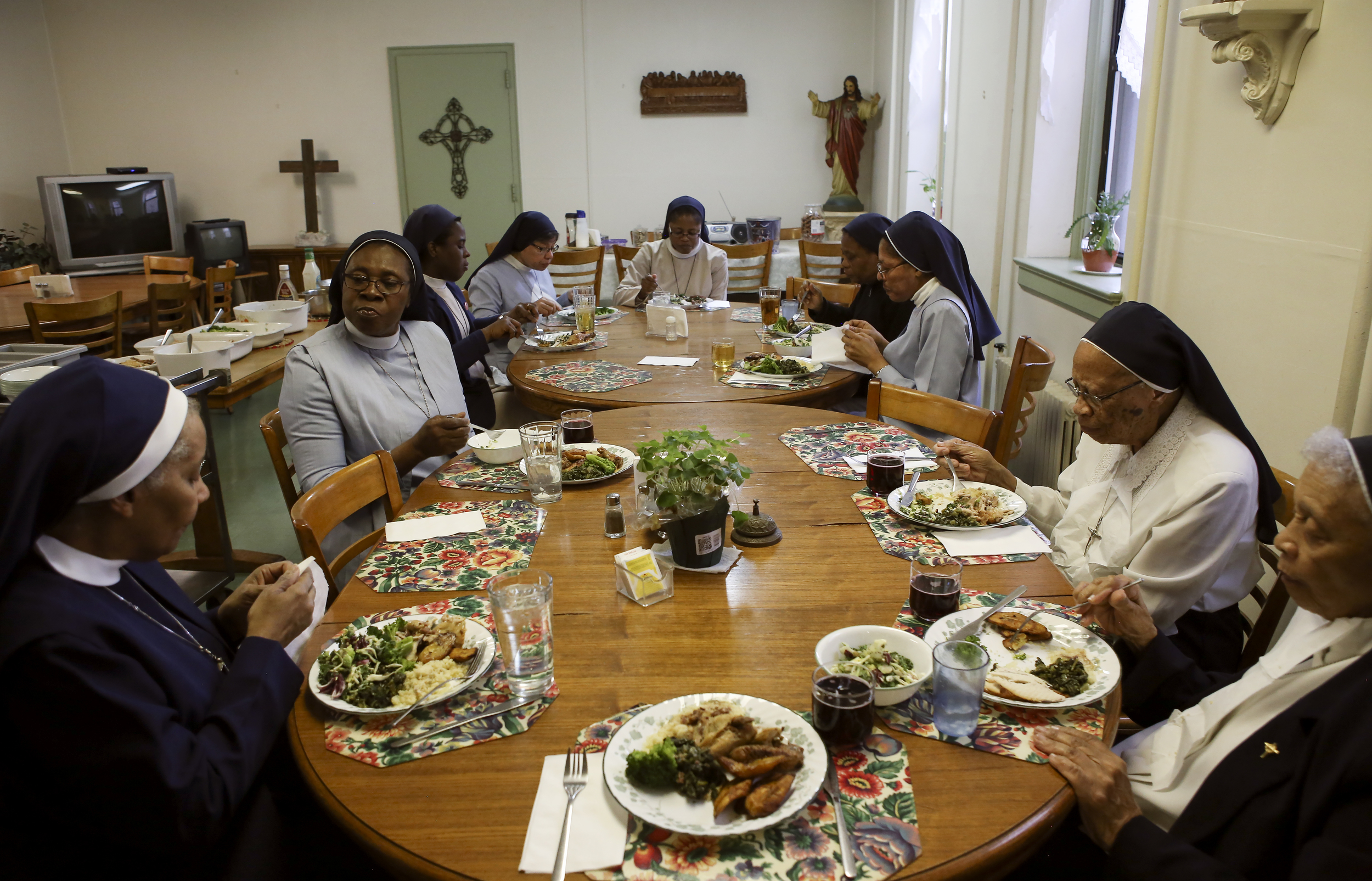 The sisters gather together for a post-mass meal on Palm Sunday.