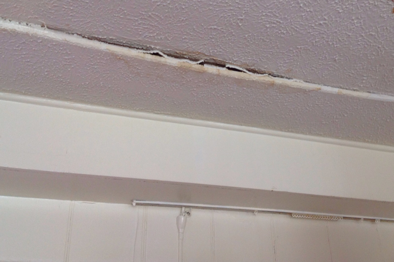 Moisture near electricity - Moisture spots in the ceiling near electricity deserves the attention of a qualified repairman.