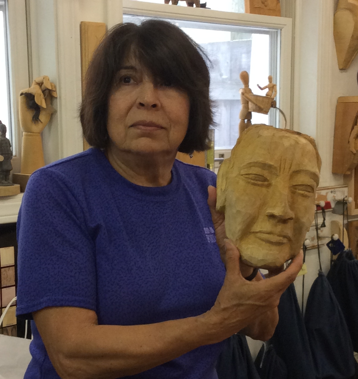 Elena is finishing up her female Native American mask as a companion piece to her male mask from a previous Balinese Mask carving workshop.