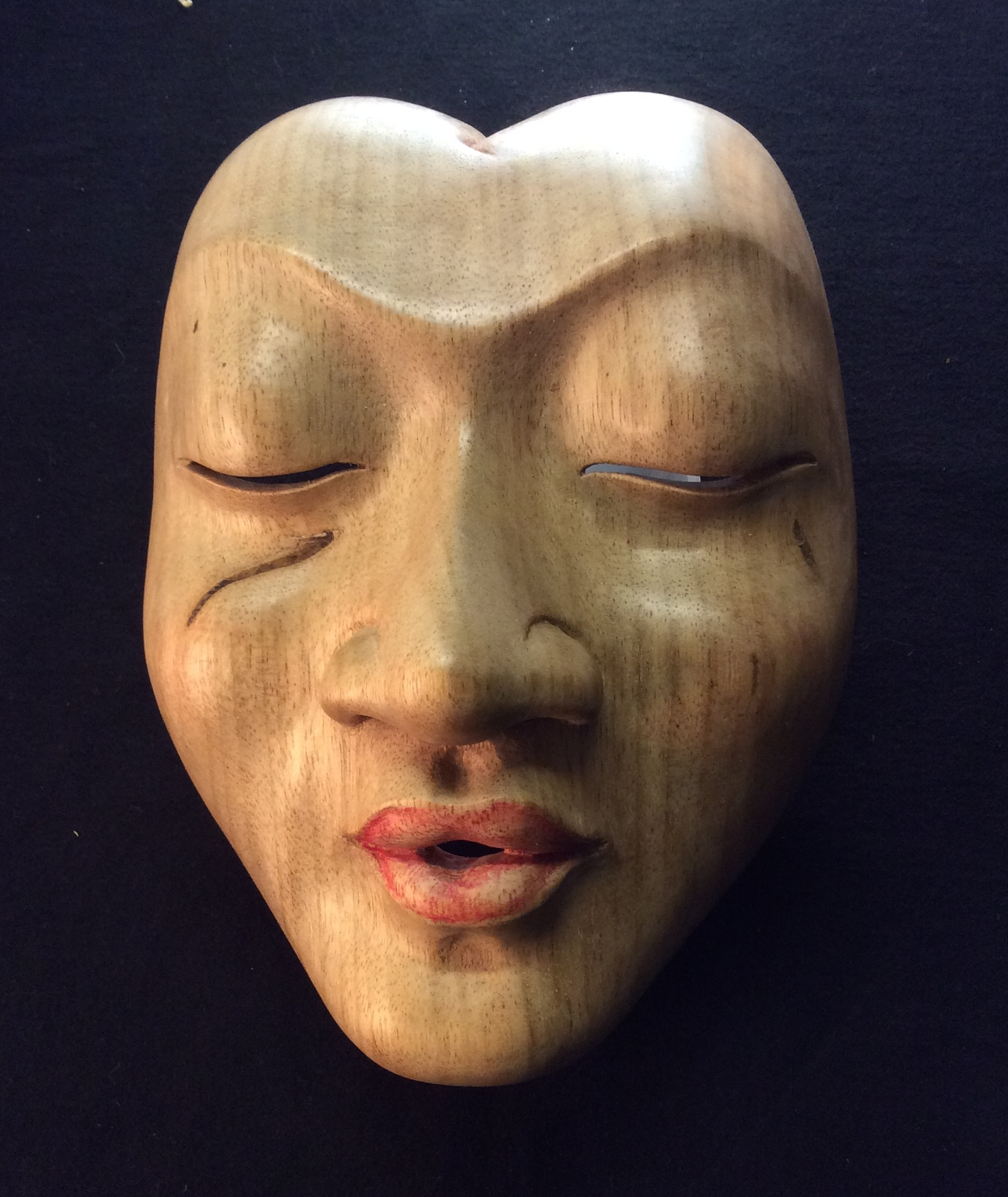Week one mask. Pule wood (some of the older, drier wood) The dark marks under the eyes are pitch pockets. I love where they ended up but had nothing to do with that. We call that lucky carving. Photo by P. Walton