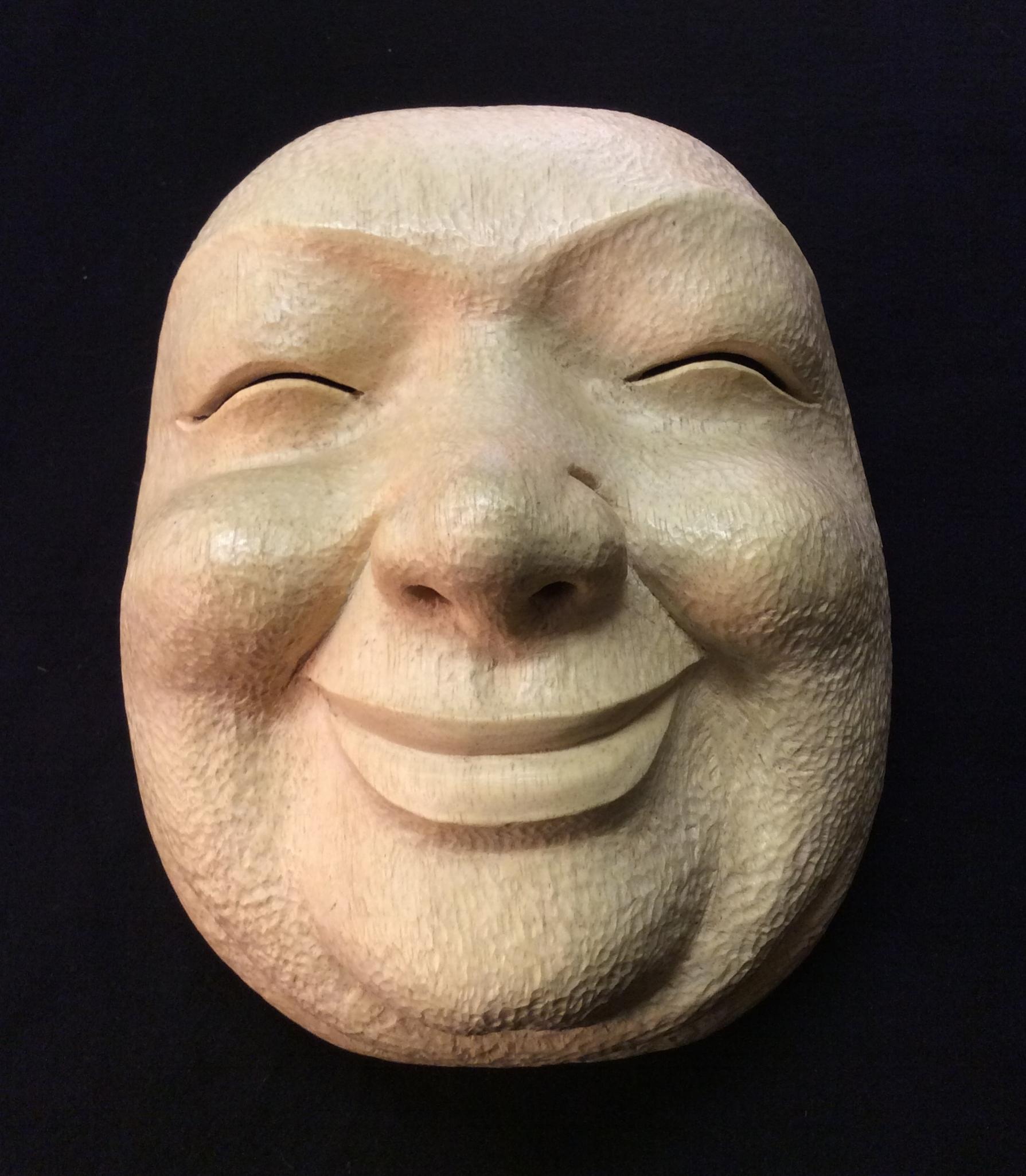 "Week one smiling mask. Pule wood (freshly cut Pule wood, repaired ""almost"" carve through ) Photo by P. Walton"