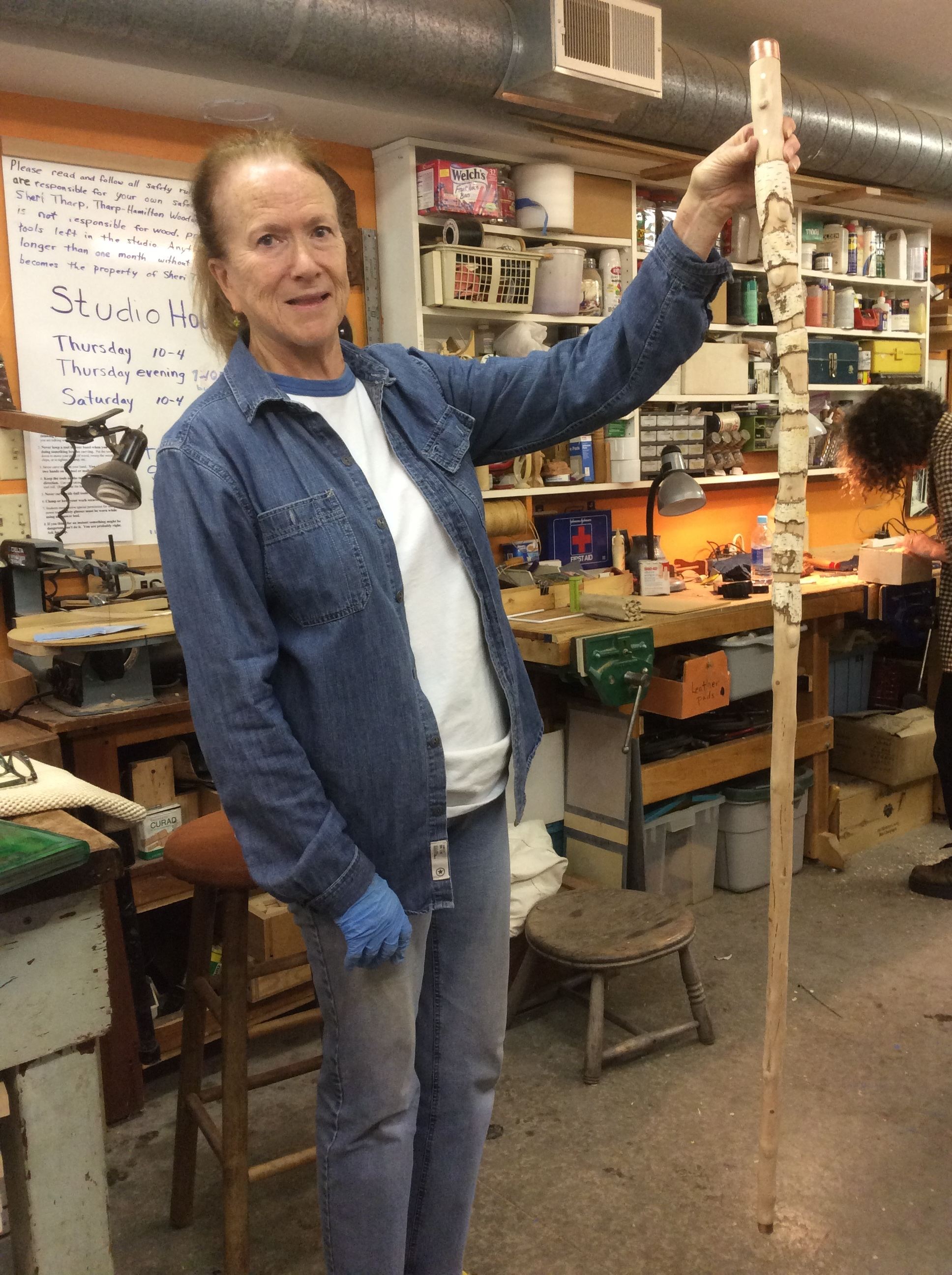 """Rise carved this staff from Birch. She left some of the bark on as random rings. The top and bottom were capped with copper and she added occasional """"dots"""" of copper by drilling and inserting heavy copper wire."""