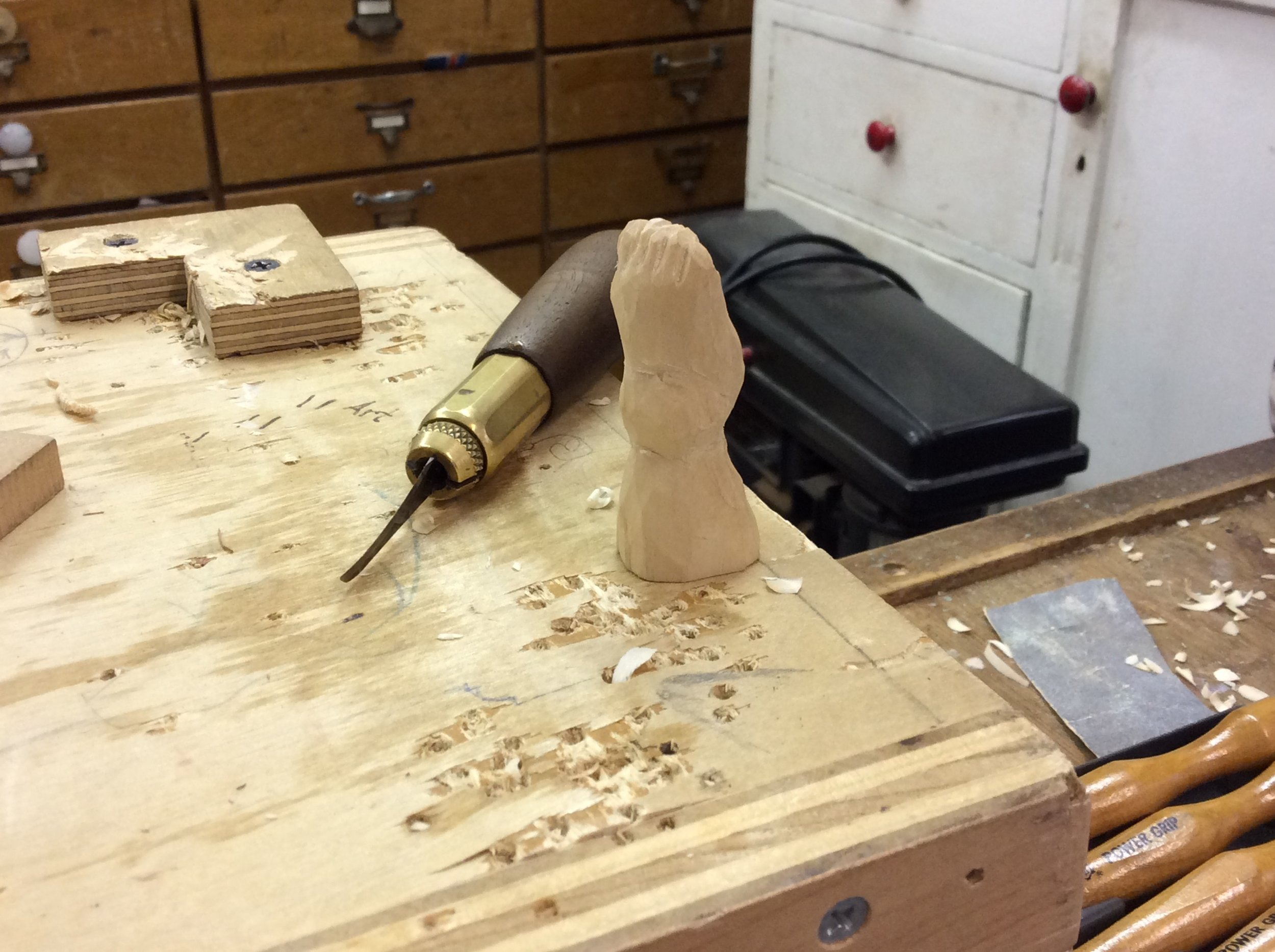 Not all carving are big.  Michael brought in this sweet foot that he is carving.