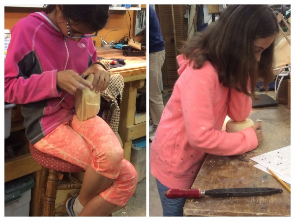 More of the younger generation of carvers, hard at work.  Maisie is using the elbow clamp technique for sanding the outside of her Alaska Yellow cedar bowl.  Bella is wrapped up with riffling her Jelutong Cat sculpture.