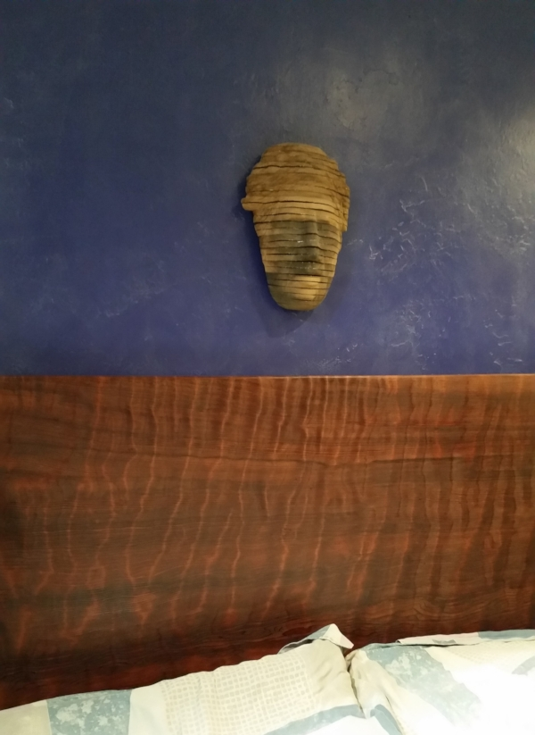 """Another end of an era project. This gorgeous 52"""" x 58"""" x 2.5"""" piece of old growth ripple grain Redwood used to be a dusty, scratched lunch room table at the cabinet shop. After lots of sanding and scraping it now has a new life as my headboard. Makes me smile."""