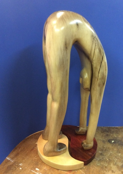 Doug brought in his completed figure doing yoga carved from Myrtle.