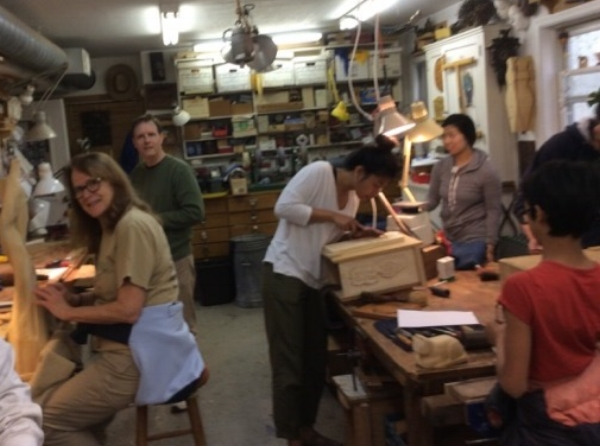 The woodcarving community of young and old working together.
