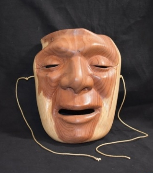 I carved this piece a bit ago. This was carved from a large branch pruned from a tree in my friend Susan Koenig's back yard. Just last month Susan had to have the huge tree removed. The mask told me he needed to go live with Susan. You don't argue with masks when they talk to you.