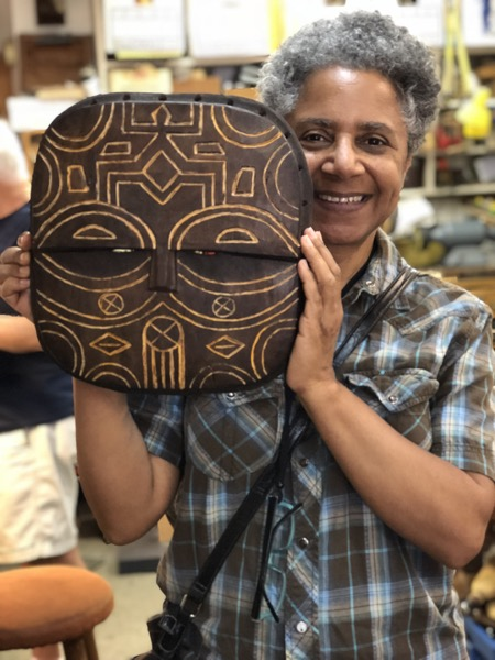 Laurie finished the wood portion of her Teke inspired mask. Lots of fiber and adornment to add. She did a beautiful job on the coloring and surface design.