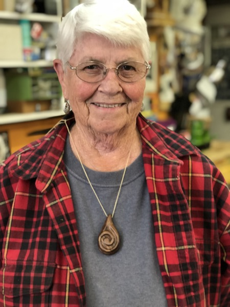 Lorraine carved this walnut spiral necklace for her niece.