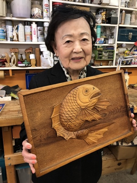 "Cookie, this lovely 89 year old was generous enough to bring and share this carving that her father carved in a Japanese internment camp. She was 12 years old at the time. She remembers that the men that carved together would get their wood from the containers that the food was delivered in. Although the piece of Pine is very detailed the wood is only 3/4"" thick x 11"" x 27"". Check out  http://50objects.org  for some interesting stories of those times."