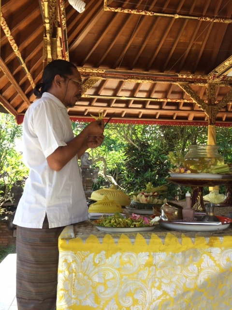 In the Balinese tradition once a year, October 27 this year, is the Anniversary of metal tools. On that day you sharpen and clean your tools and offer thanks to them for allowing you do your work. Here is Anom offering blessings in Bali.