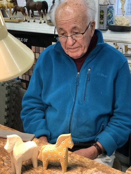 A big welcome to George who recently joined our Thursday group after moving from North Carolina. George started knife carving when he retired 30 years ago. He is an expert with a whittlingknife. Here he is working on the first of several traditional Swedish carved (Dalecarlian horse or Dala) horses that he has planned for Christmas gifts. The one on the right is one he completed previously and has the most delightful textural painted flowers. I can't wait to see the process for painting them.