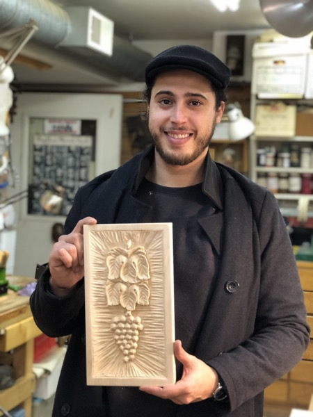 Emilio shows off his Grapes and Leaves. Emilio has been a self taught woodcarver and much to my delight did not have any awful habits to unlearn. Great job.