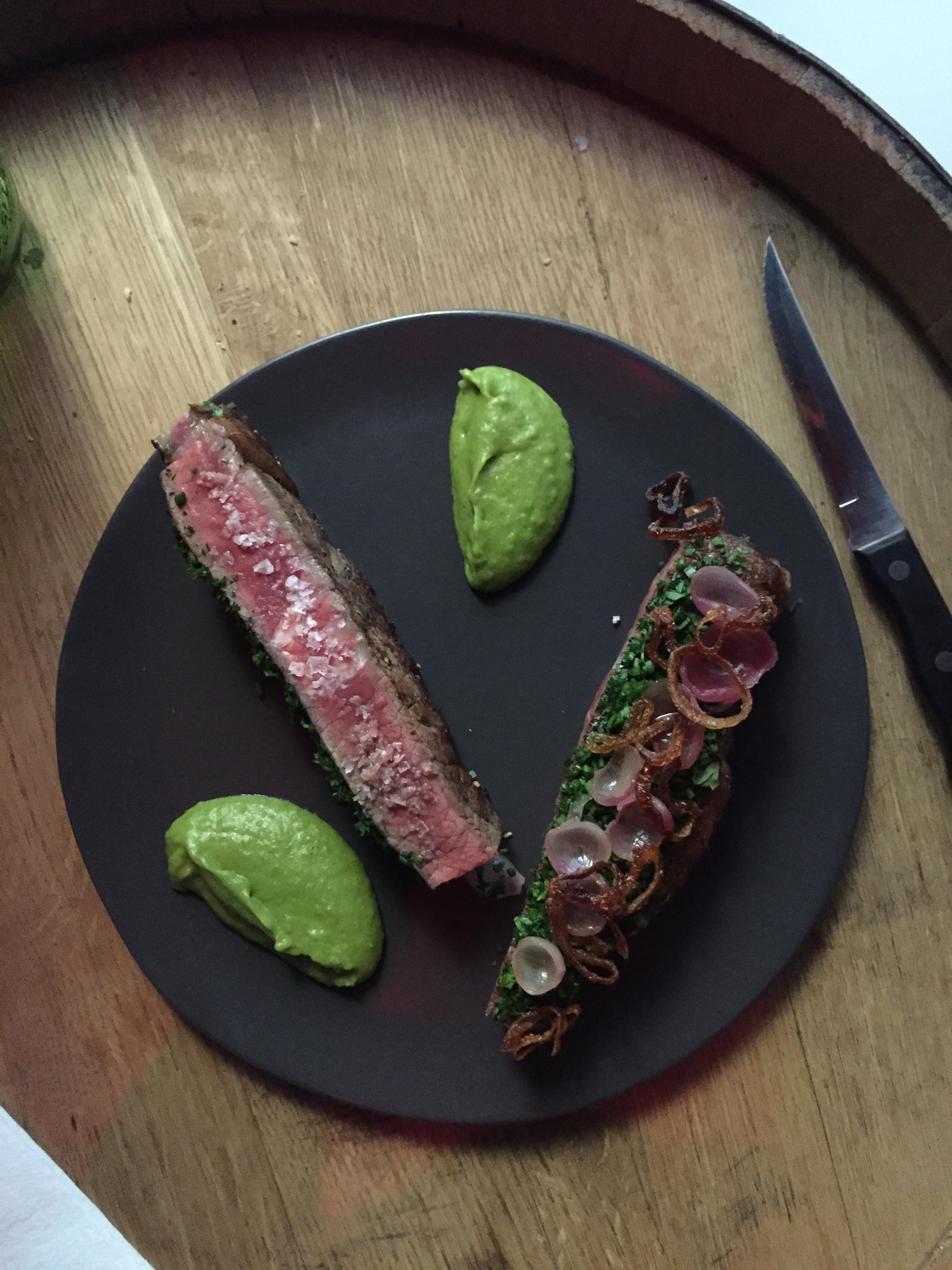 The NY Strip served with a potato spinach puree.