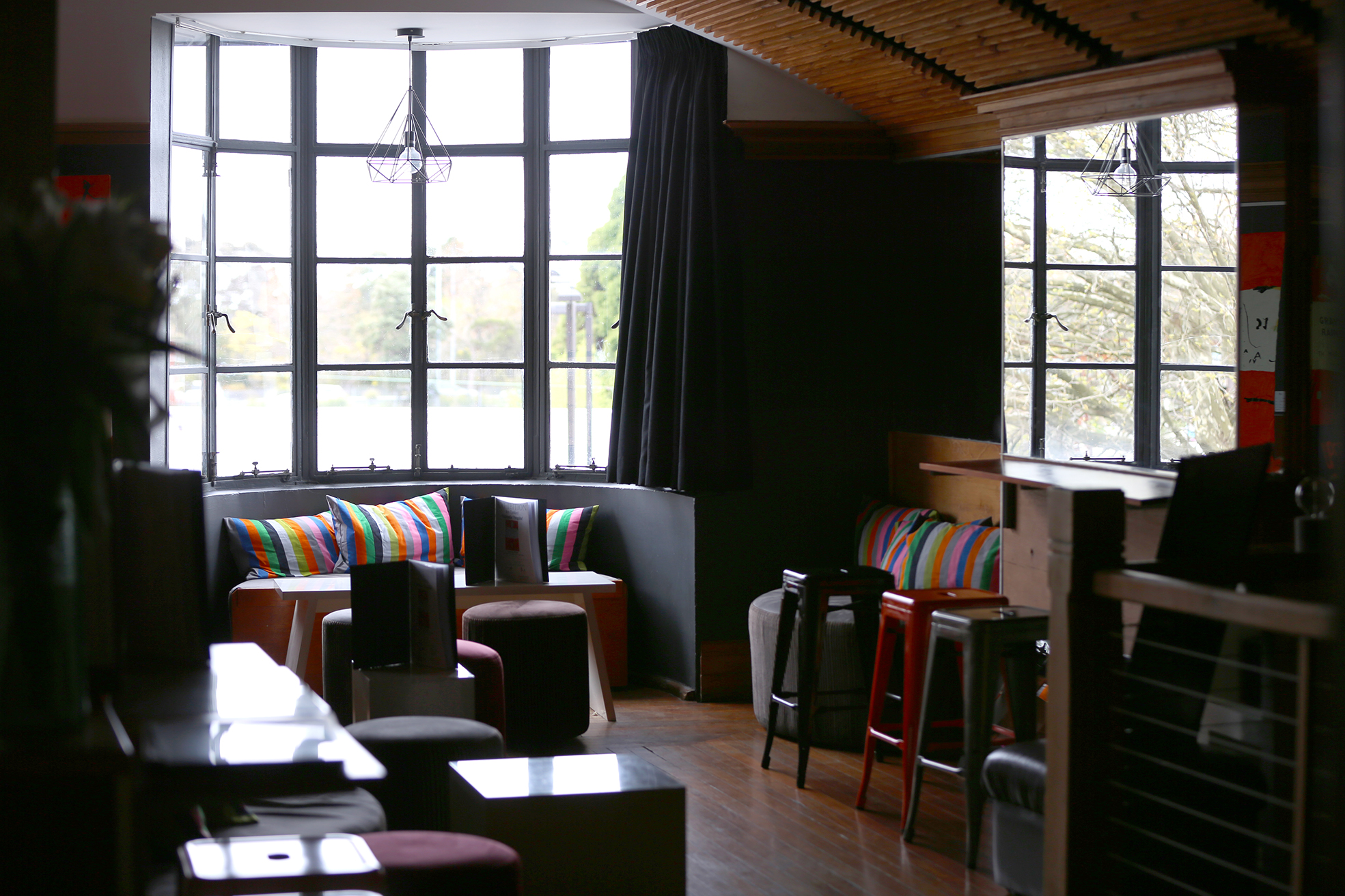 Upstairs at Palette Dining with huge windows overlooking the street below.