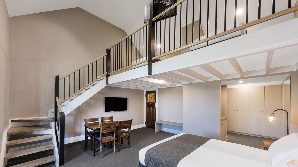 Heritage Family Mezzanine - A luxurious two-level family room which preserves its historic charm while offering contemporary furnishings.⨠ View Room Details