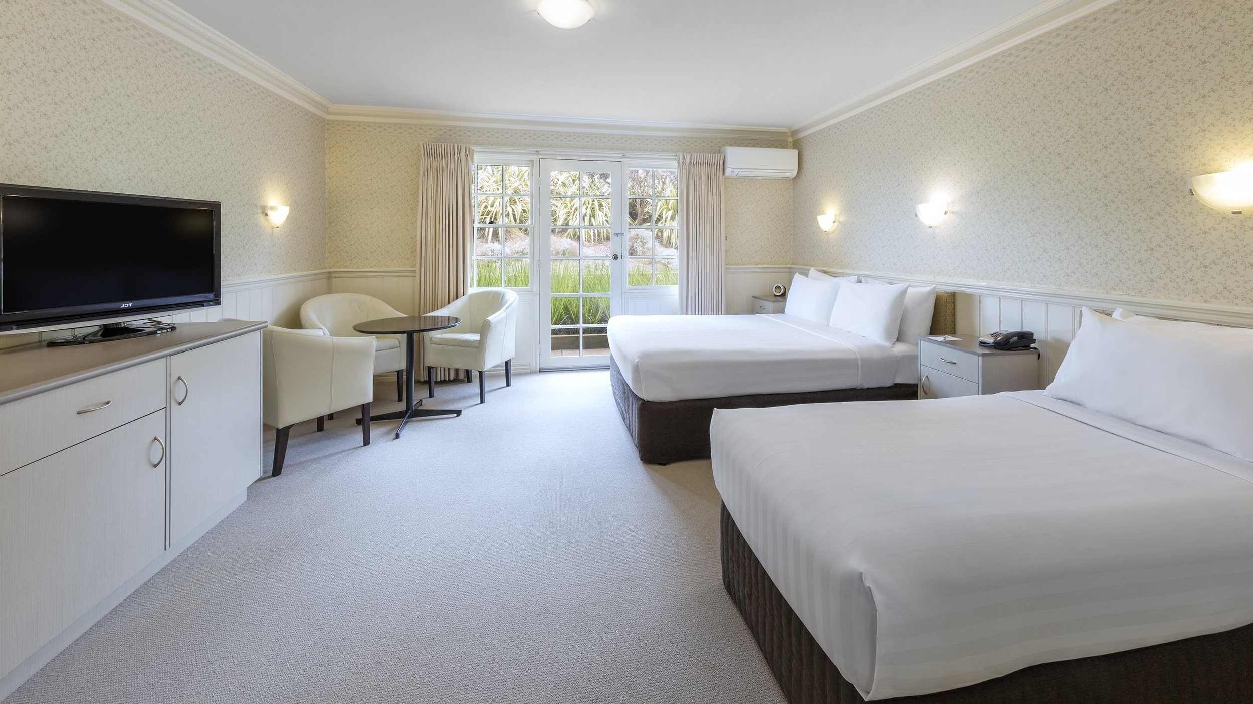 Premium Twin - A modern, spacious guest room with a flexible bedding configuration of 1 x queen bed & 1 x single bed.⨠ View Room Details