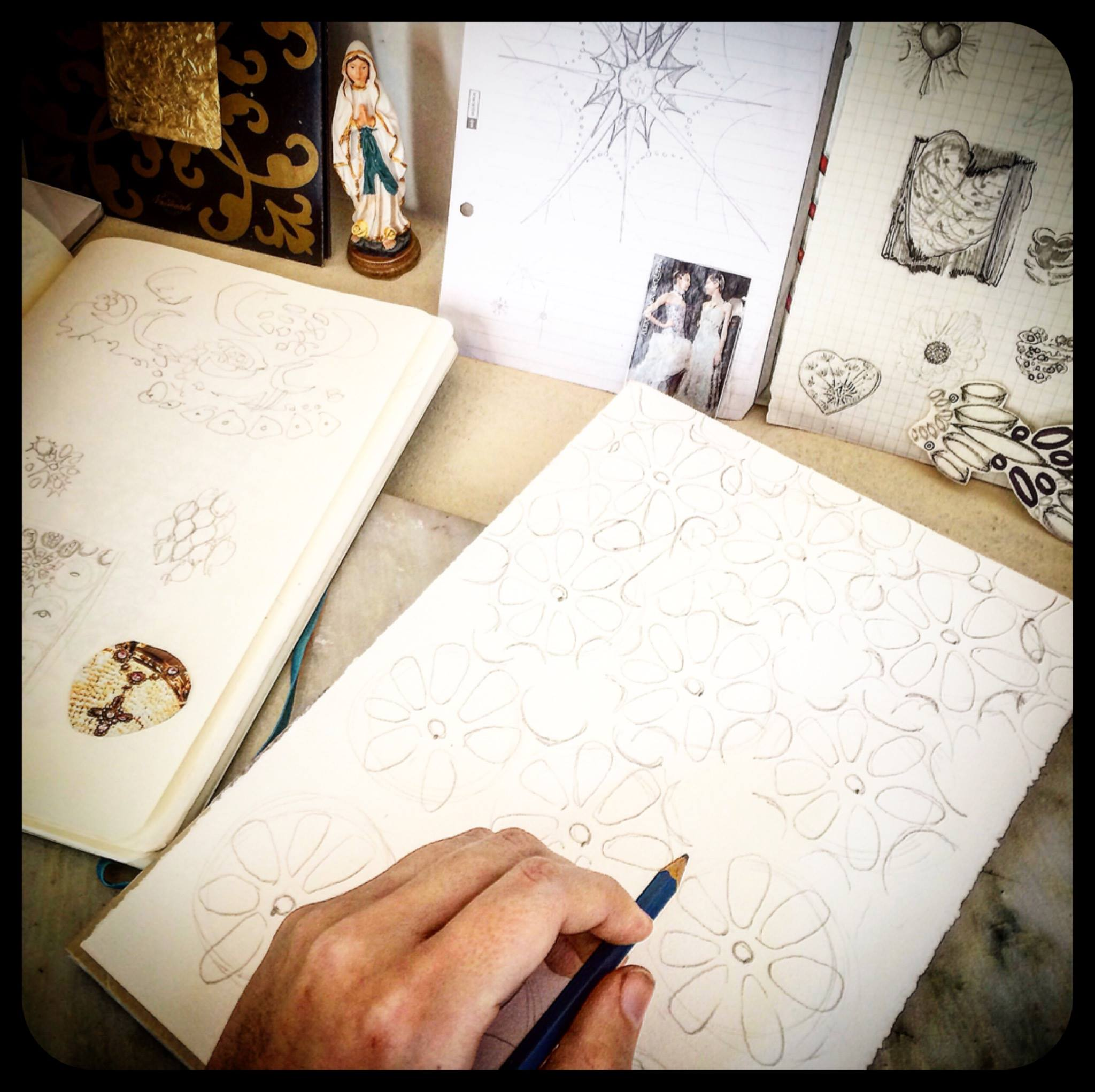 """Day 2: Once I've got a basic idea for the design I want to create, it's time to start sketching. I still keep all the """"dreamboard"""" elements nearby; throughout the whole process, staying close to what inspires me helps keep the design coherent."""
