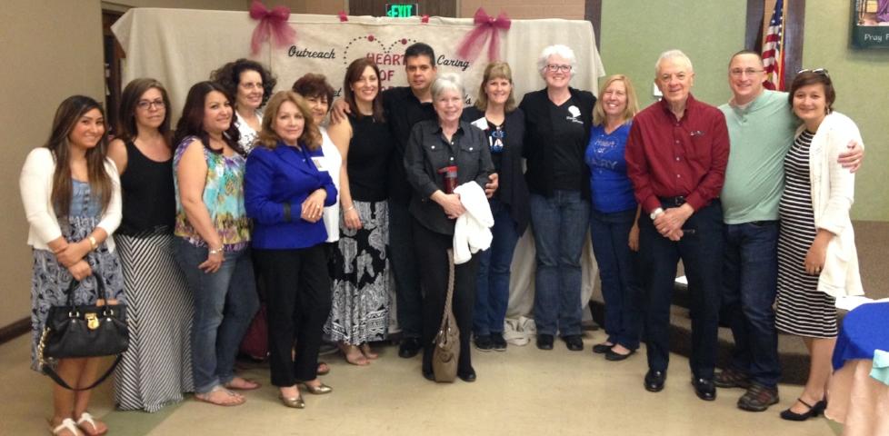 Barbara (center left in black & white skirt) surrounded her family and Heart of Mary members