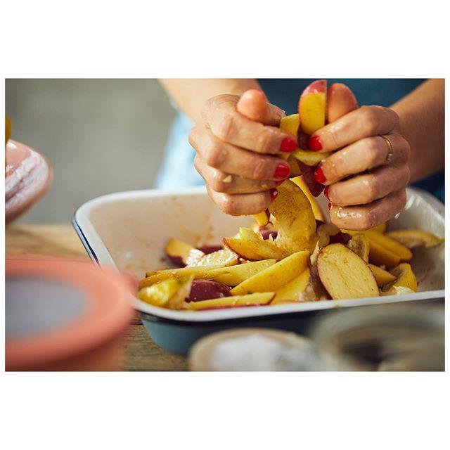 Coating some potatoes with lemon wedges, olive oil, oregano seasoning and garlic before roasting!